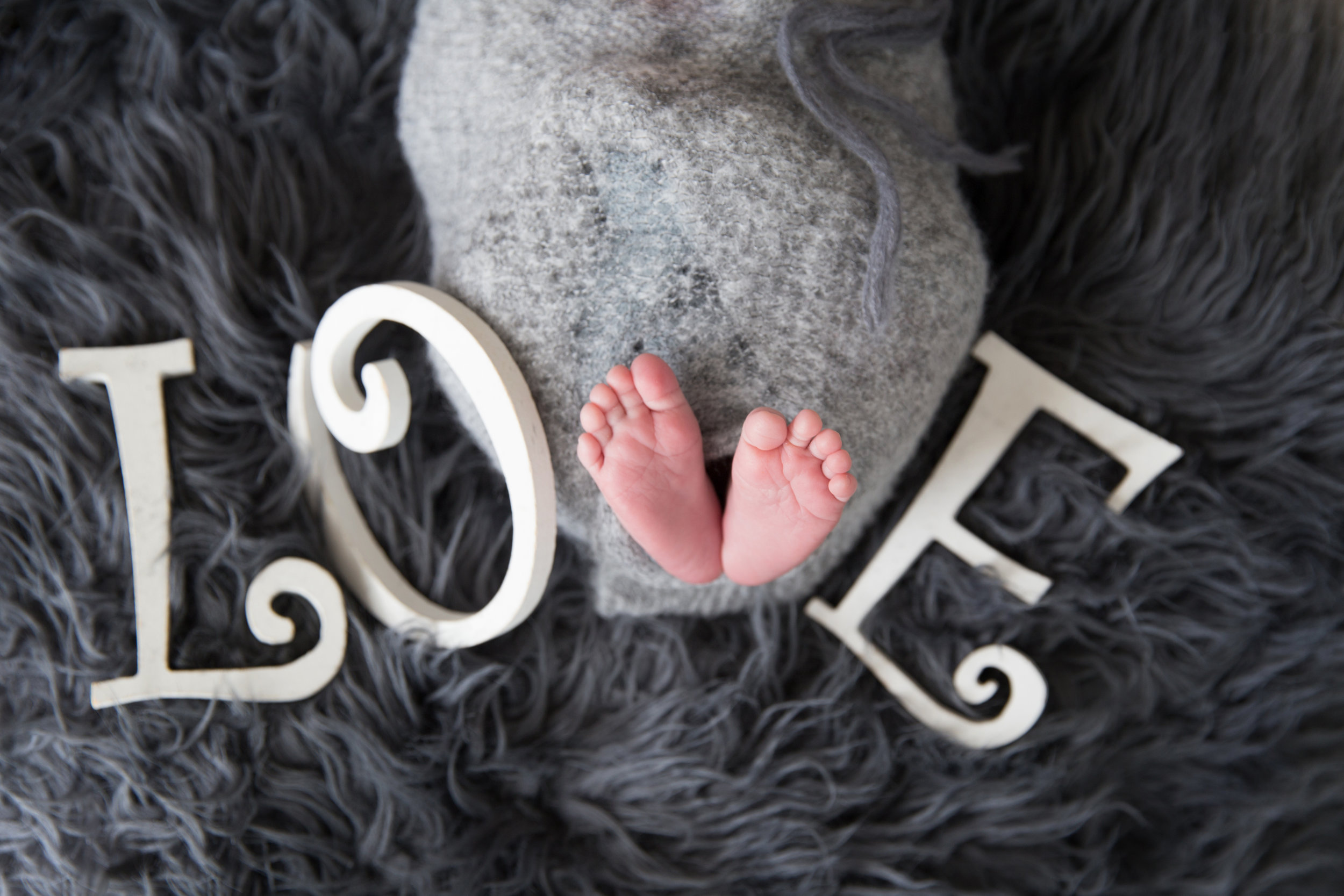 "Little feet make a nice letter ""V"" for the word LOVE. Newborn photoshoot. Milashka Photography"