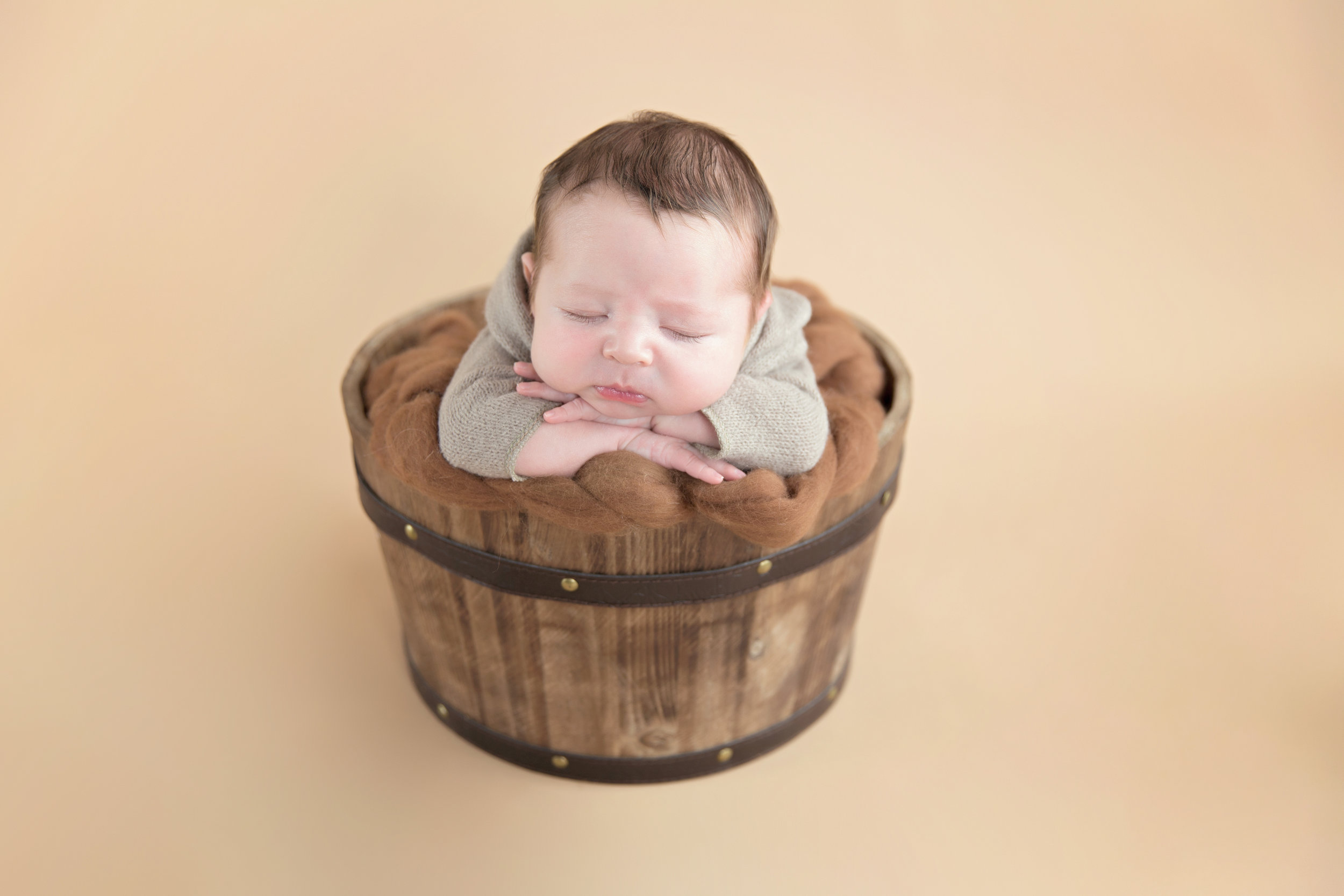 Newborn baby boy in a bucket. Calgary Newborn Photographer. Milashka Photography