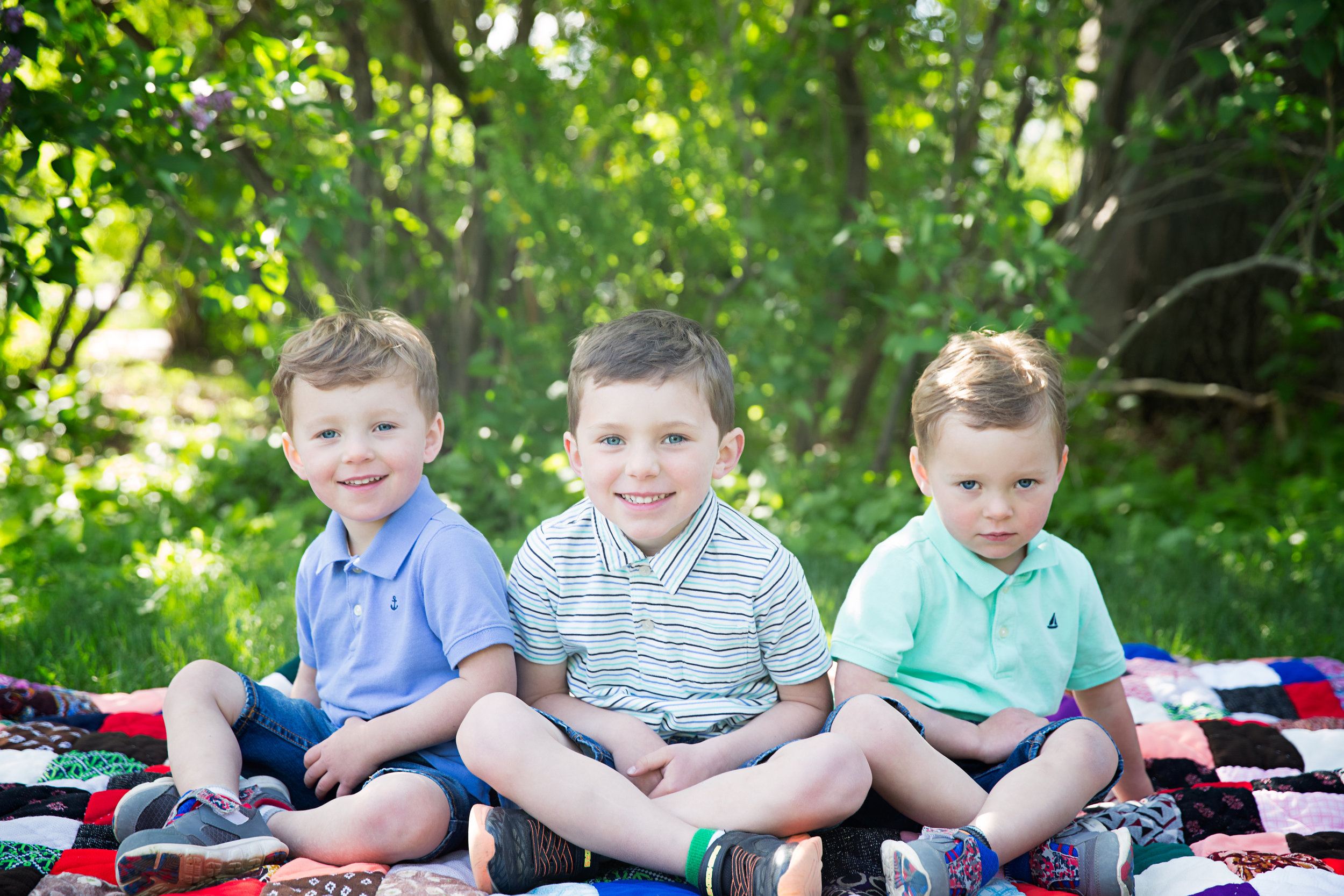 3 brothers sitting on a blanket. Twins and their older brother. Rotary Park. Calgary Photographer. Milashka Photography