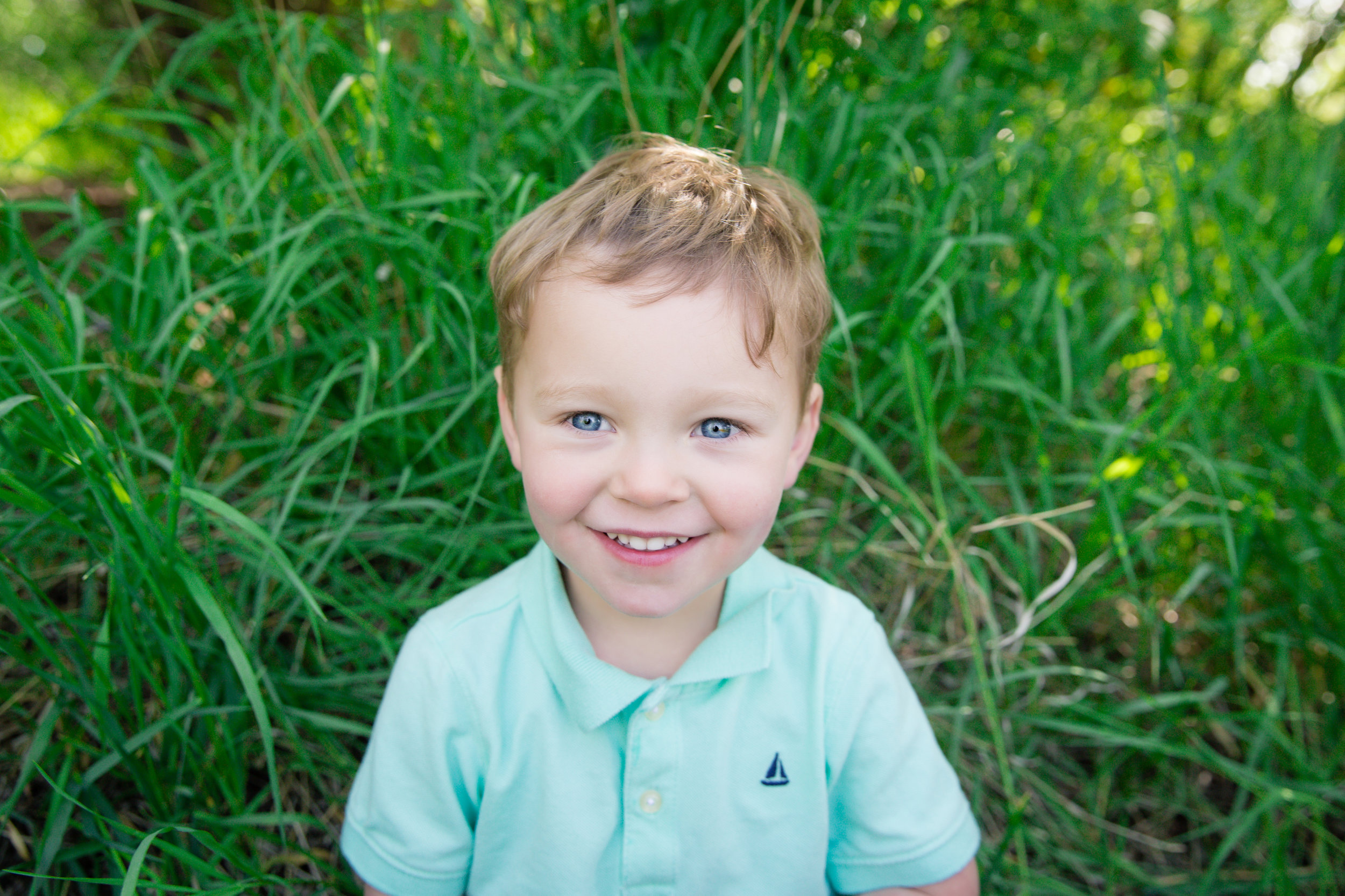 Boy is smiling. Calgary Child photographer. Milashka Photography