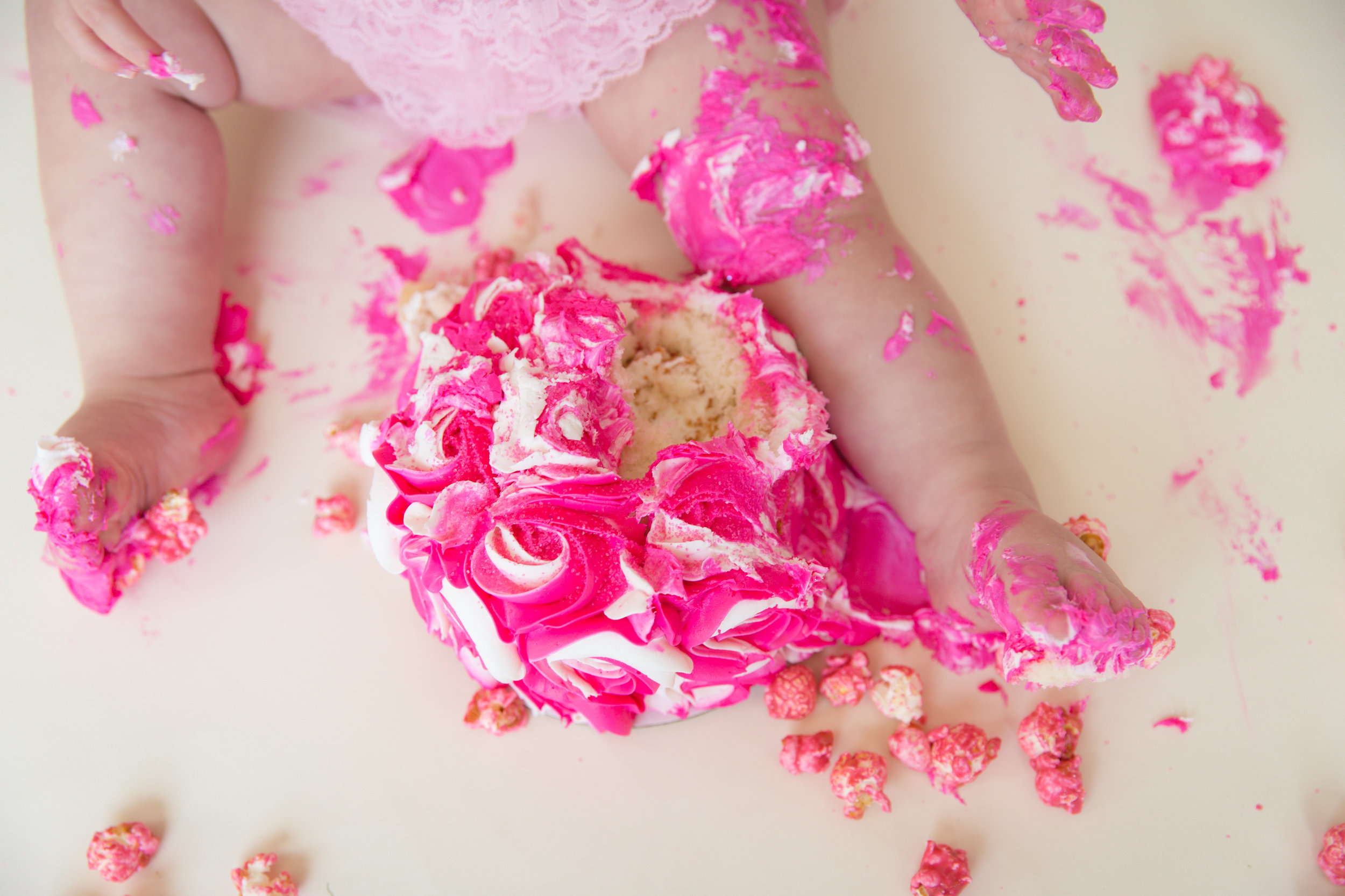 Little feet covered in cake and pink icing. Calgary cakesmash photographer. Milashka photography.