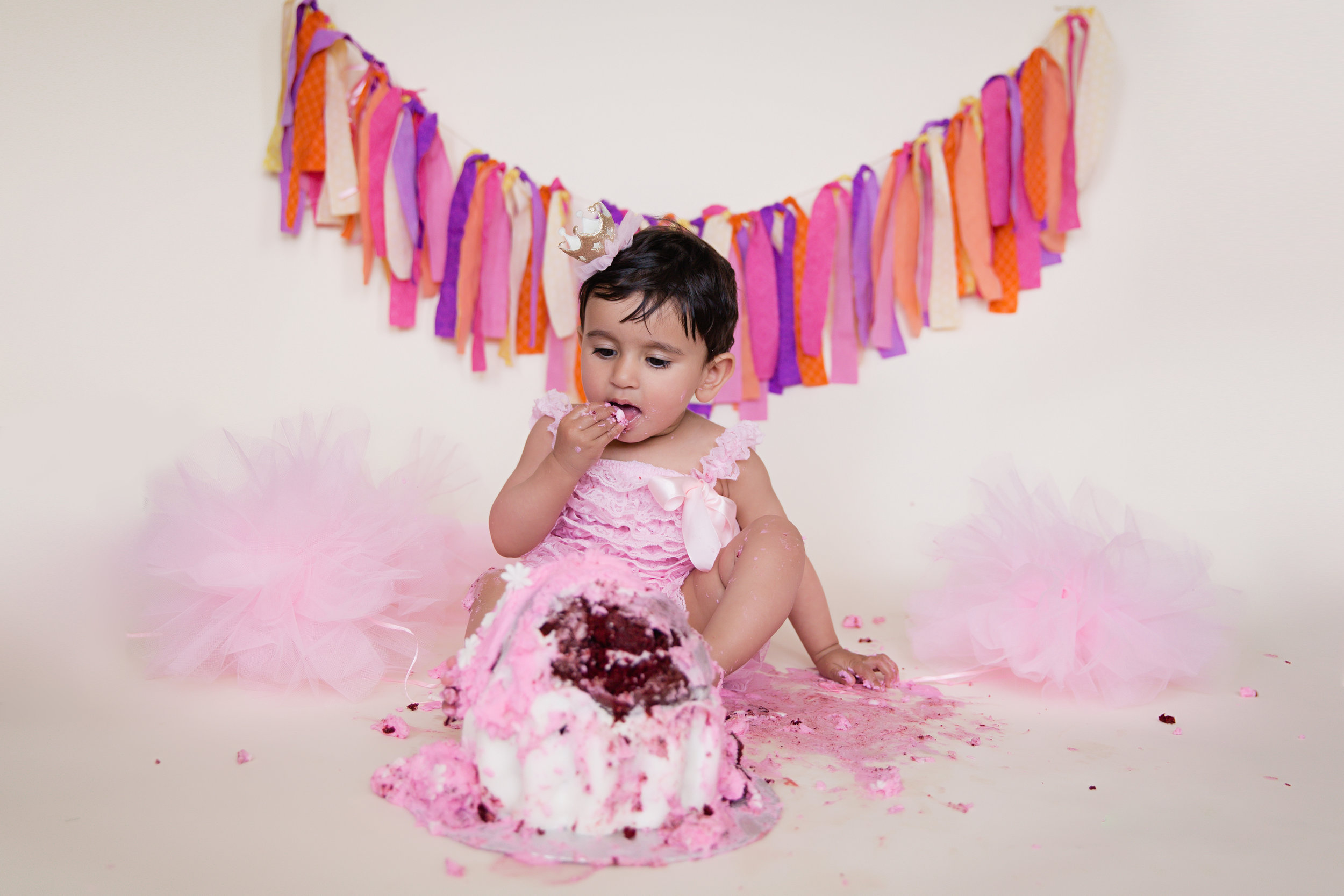 Birthday girl trying her cake. Cake Smash Photoshoot ideas. Calgary baby photographer. Milashka Photography