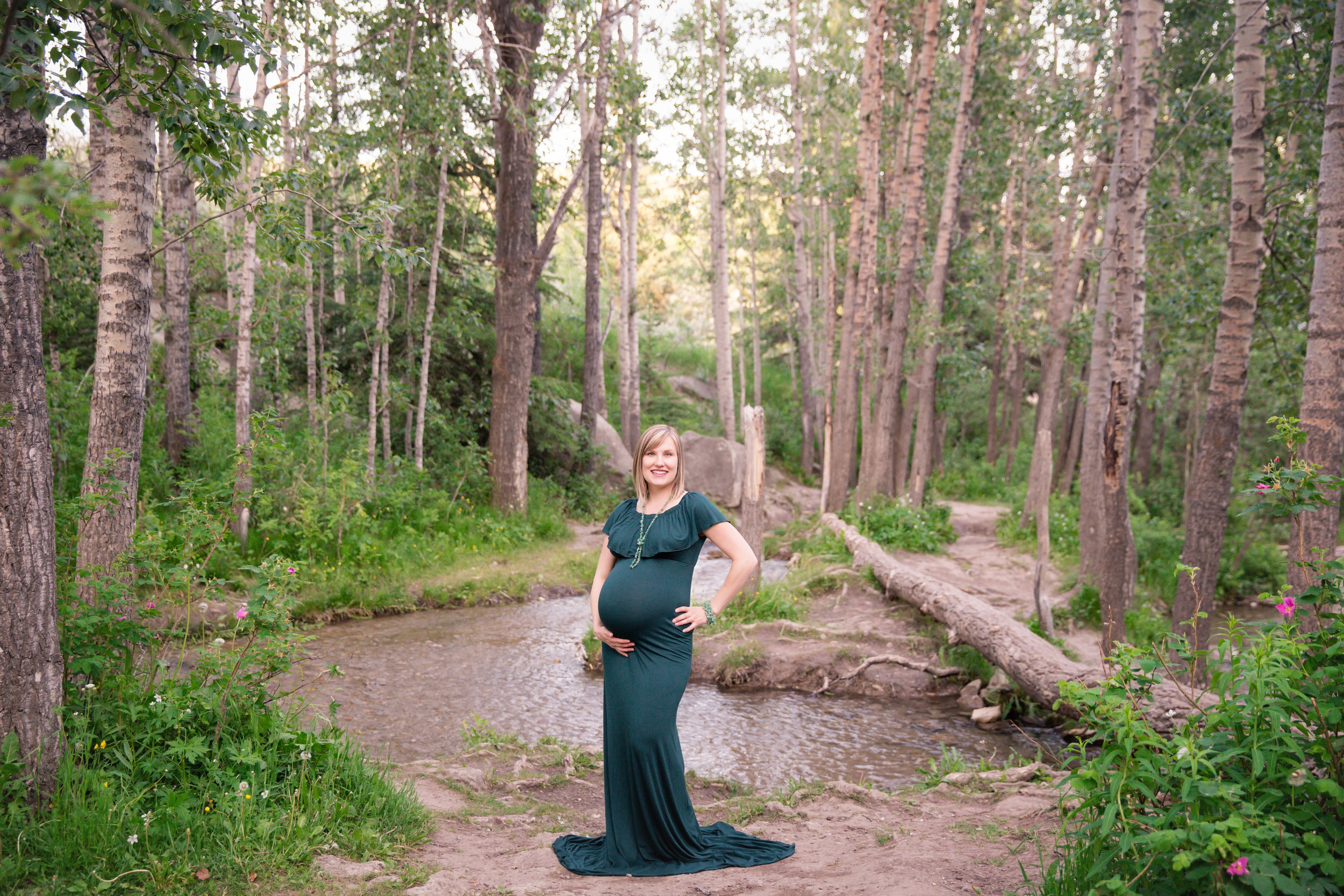 Beautiful mother - to - be wearing a gorgeous green gown at the Big Hill Springs Provincial Park. Calgary Maternity Photographer - Milashka Photography