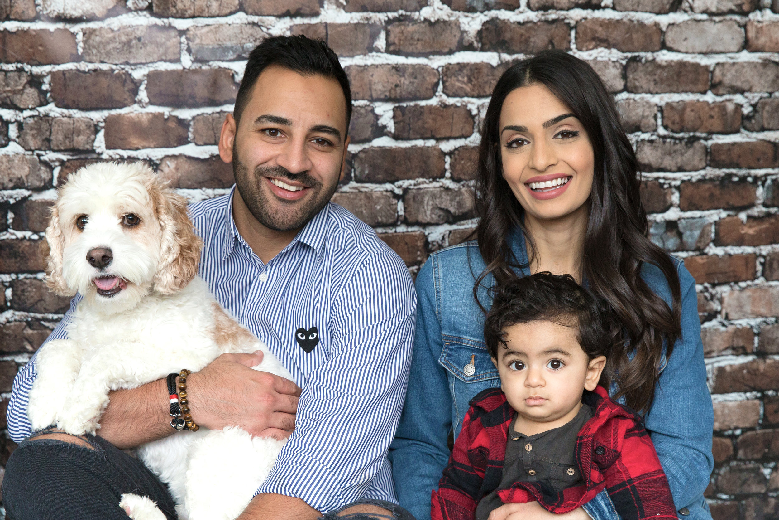 Family portrait. Parents, toddler and a dog. Calgary Family photographer. Milashka Photography