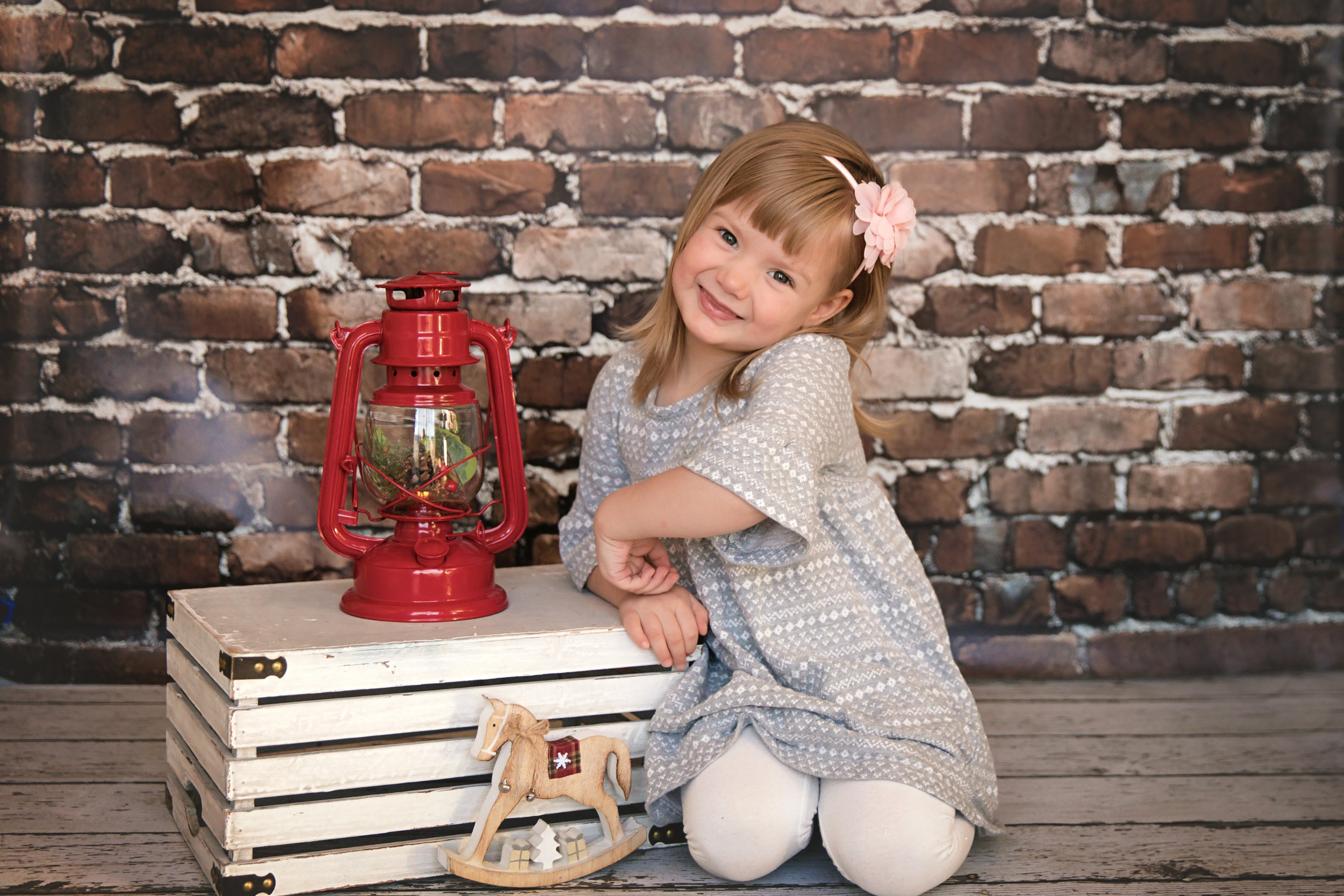 Sweet little girl smiling in this Christmas inspired photoshoot. Calgary family photographer. Milashka Photography