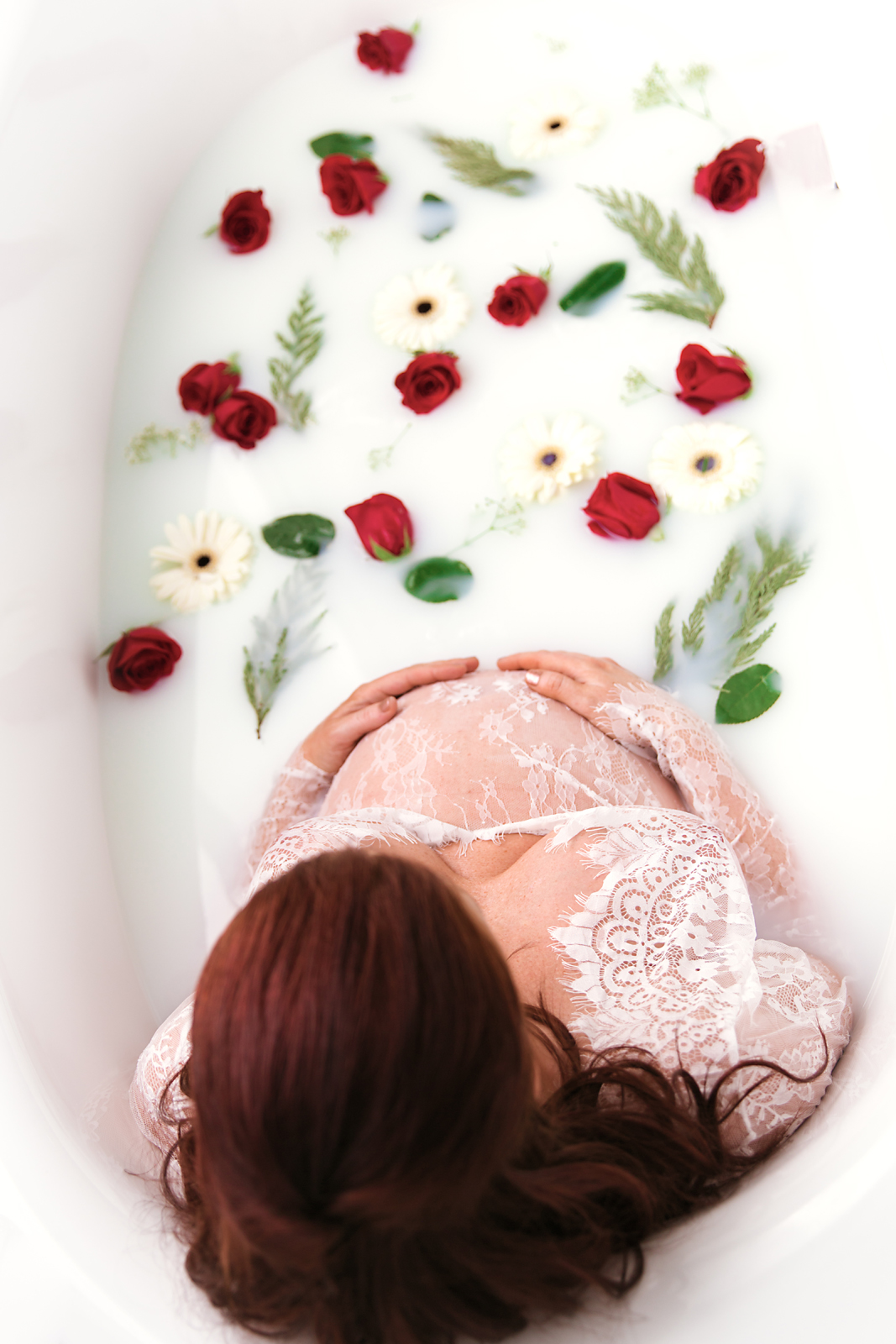 Milk Bath maternity session. Mom-to-be in the bathtub full of milk and flowers. Calgary and area maternity photographer - Milashka Photography