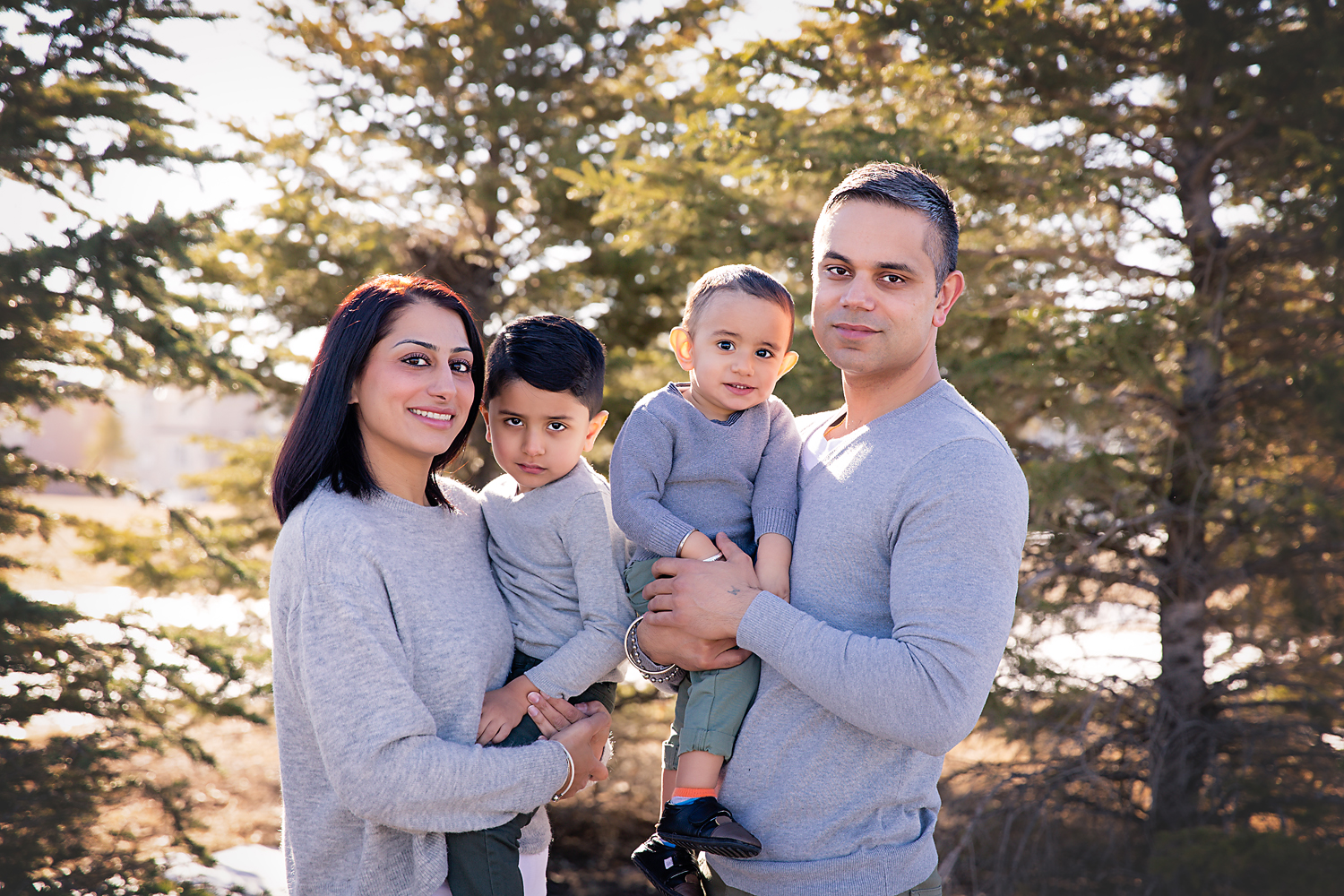 Portrait of a family of 4 - mother, father and 2 sons. Family photoshoot ideas - Calgary Family Photographer
