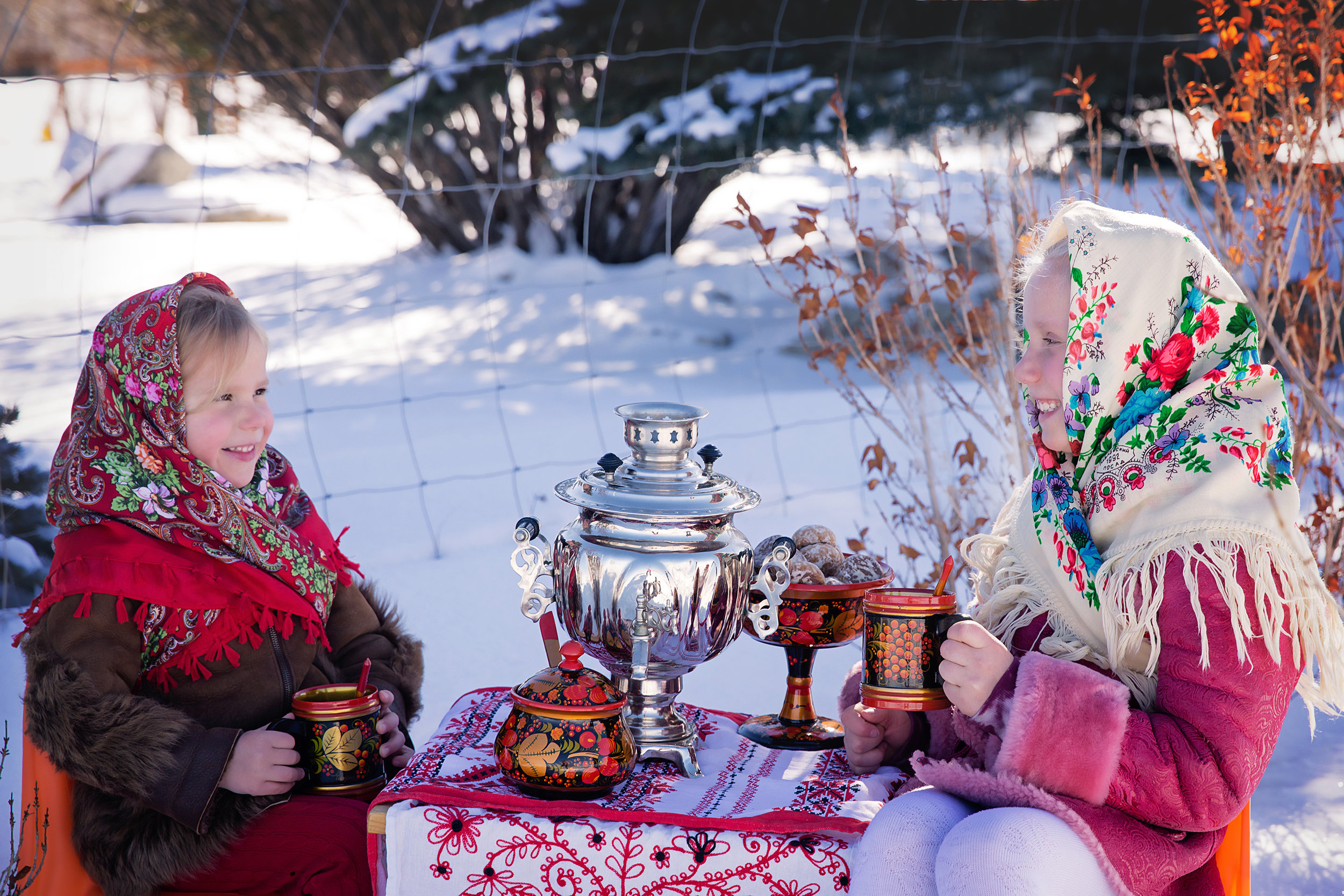Russian inspired photoshoot. Two sisters are dressed in Russian traditional clothes and drinking tea from Russian traditional dishes and Samovar. Russian Canadian Photographer - Milashka Photography