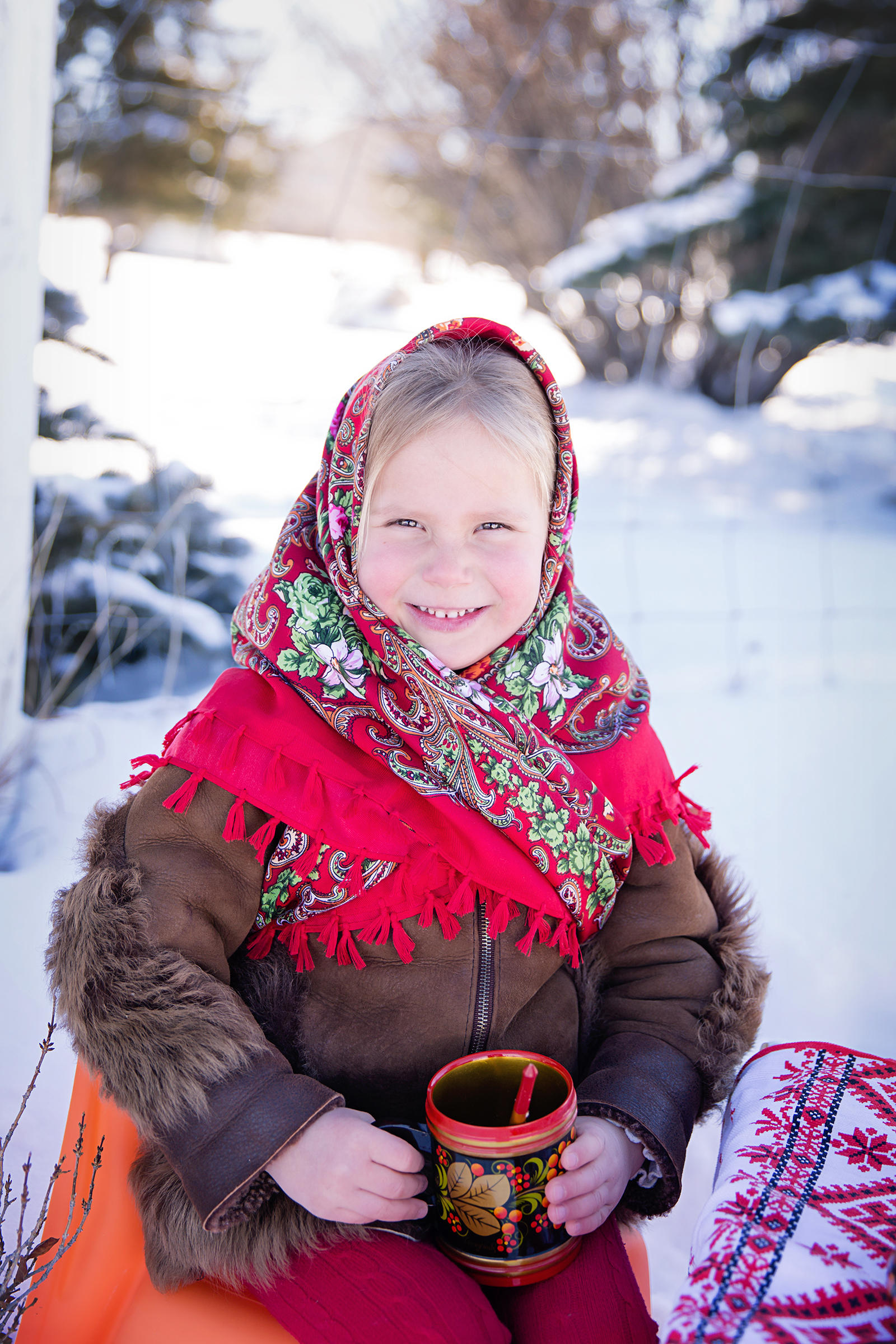 Russian girl. Dressed in Russian traditional clothes and holding a Russian dish. Calgary Russian Photographer