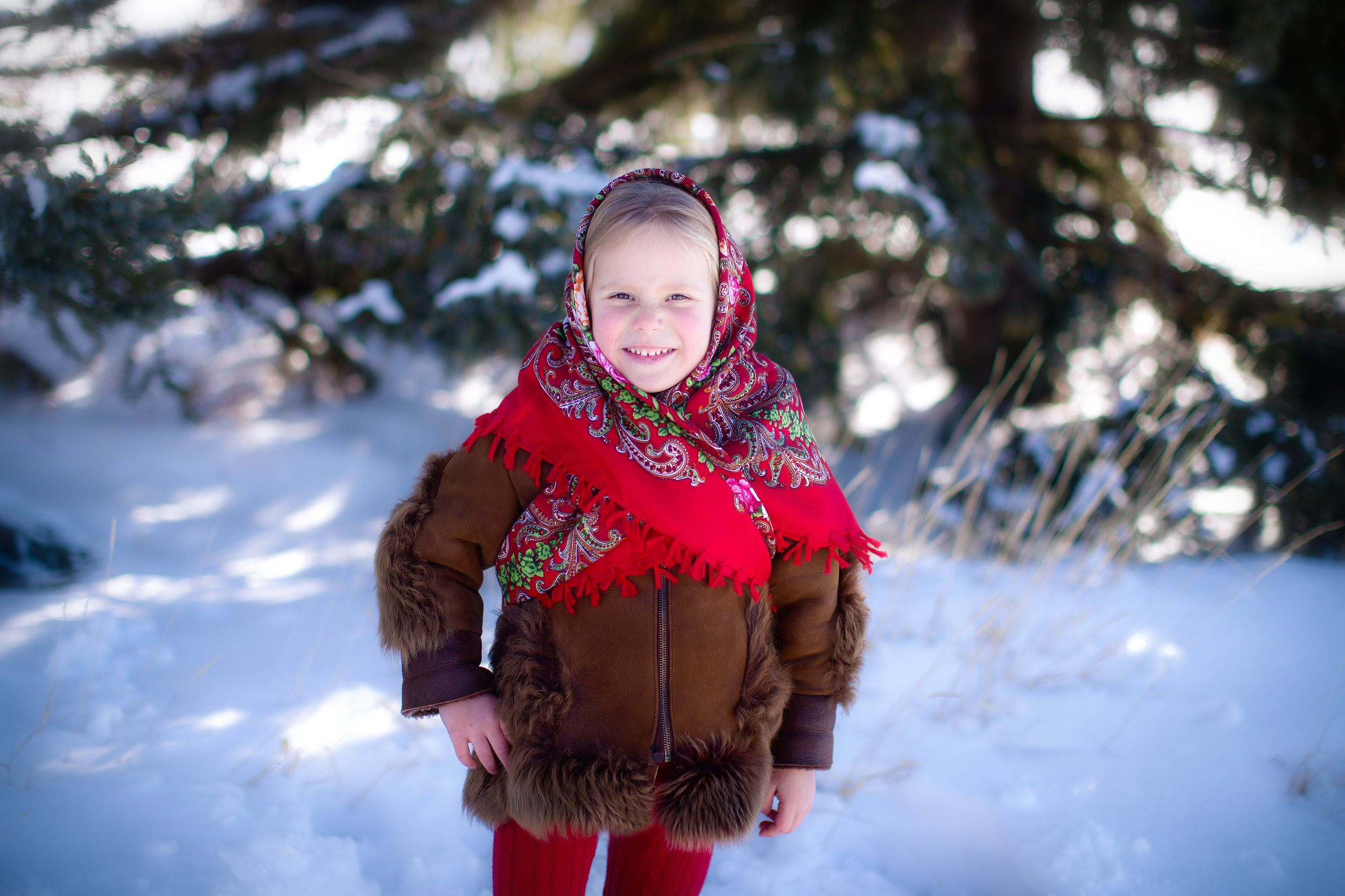 Russian Girl. A little girl dressed in traditional Russian clothing during winter. Calgary Child photographer - Milashka Photography