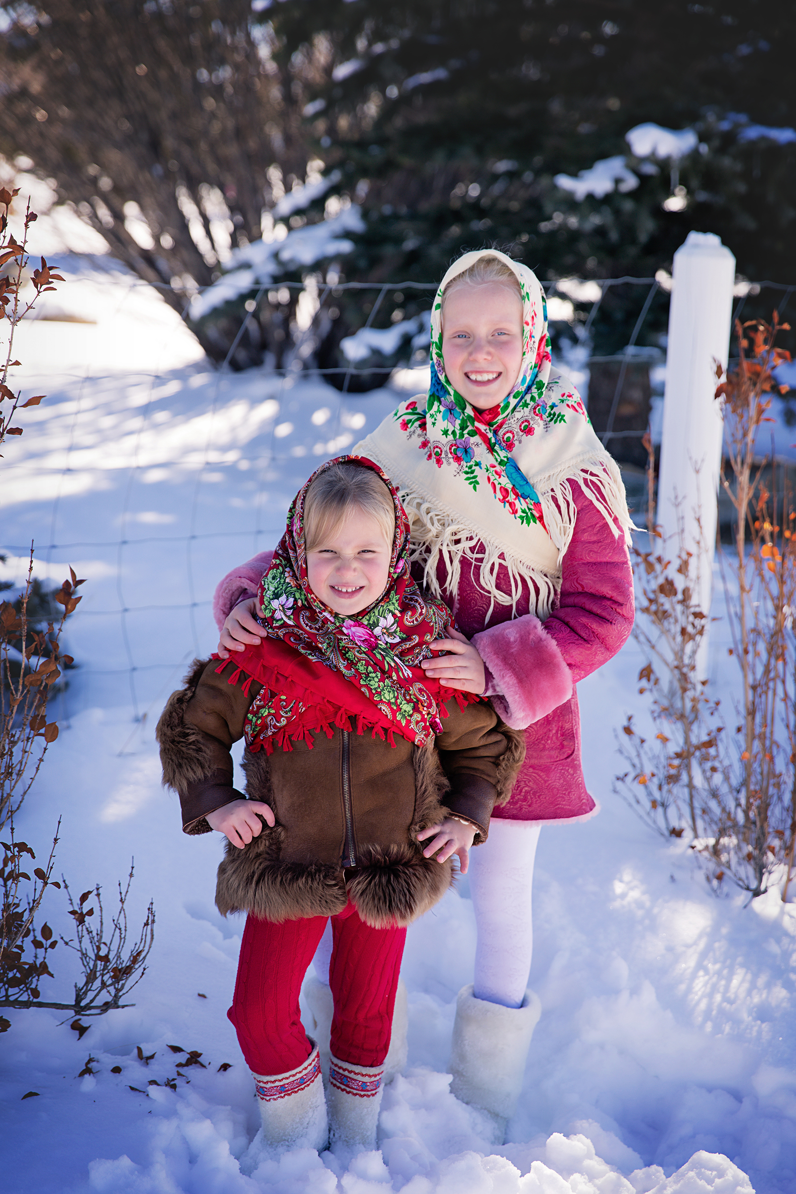 Russian sisters. Two sisters are dressed in Russian traditional clothes during Maslenitsa. Russian Canadian photographer - Milashka photographer