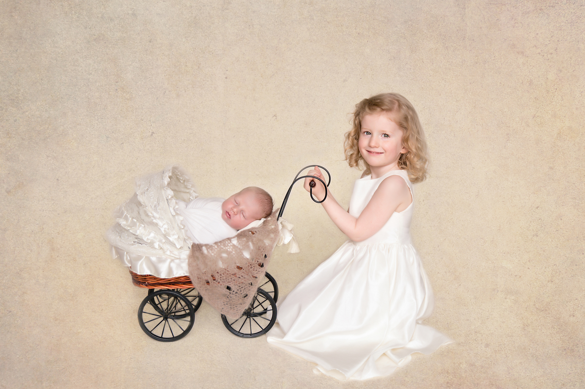 Siblings shot - newborn photography. Sister is posing with her newborn baby brother in a stroller. Calgary Newborn and Baby photographer - Milashka Photography.