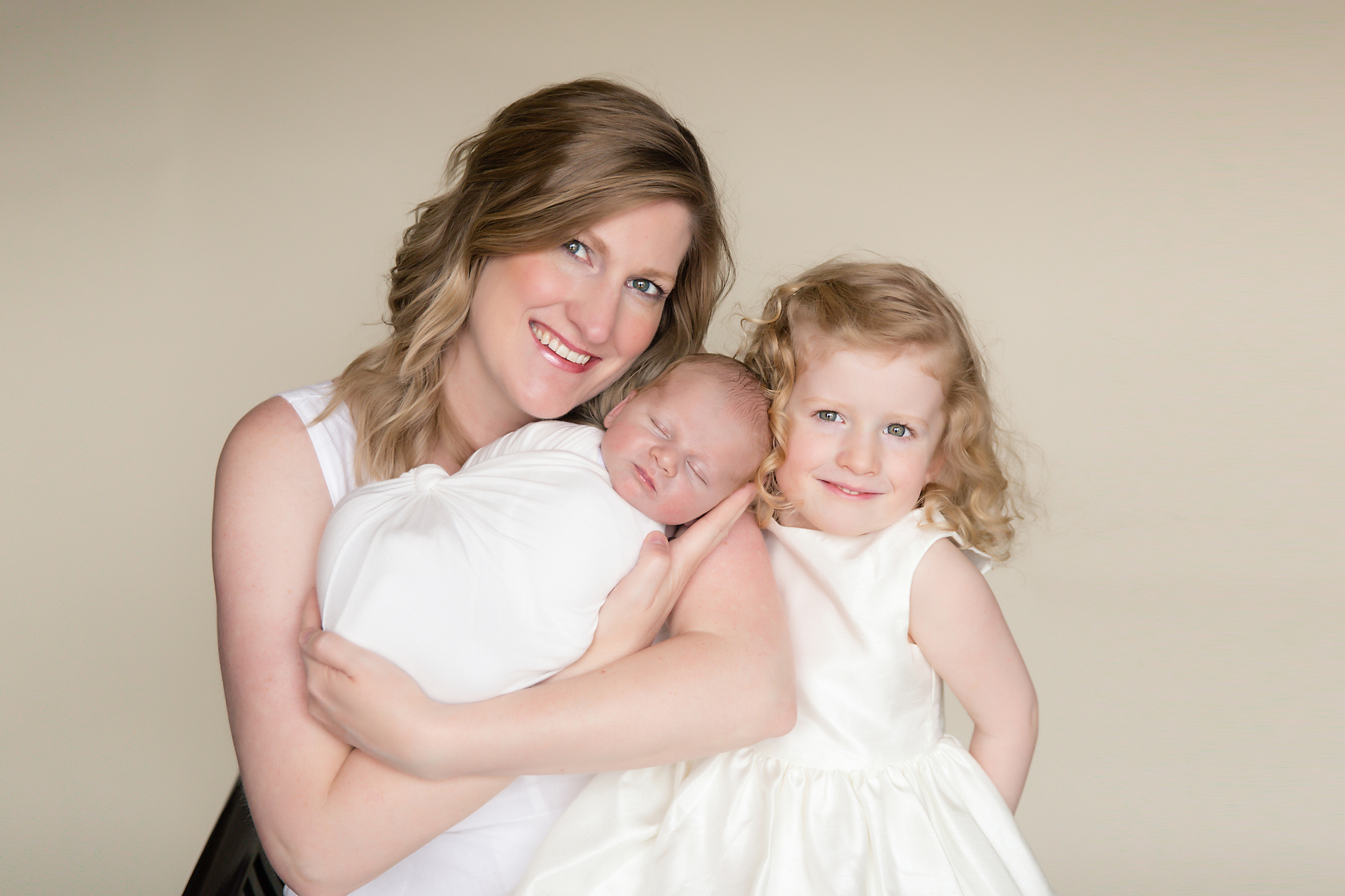 Mother and her two children - newborn baby boy and a 4 year old daughter. Calgary Newborn and Baby photographer - Milashka Photography.