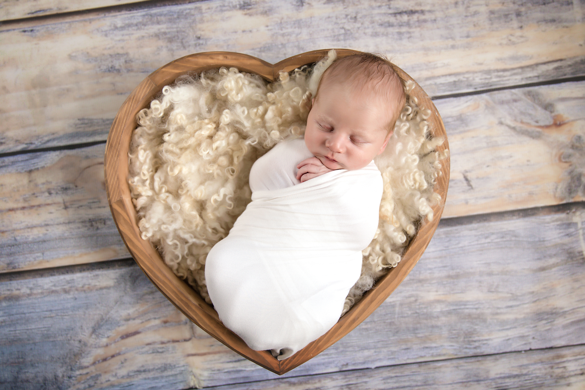 Baby boy posed in a heart bowl. Calgary Newborn and Baby photographer - Milashka Photography.