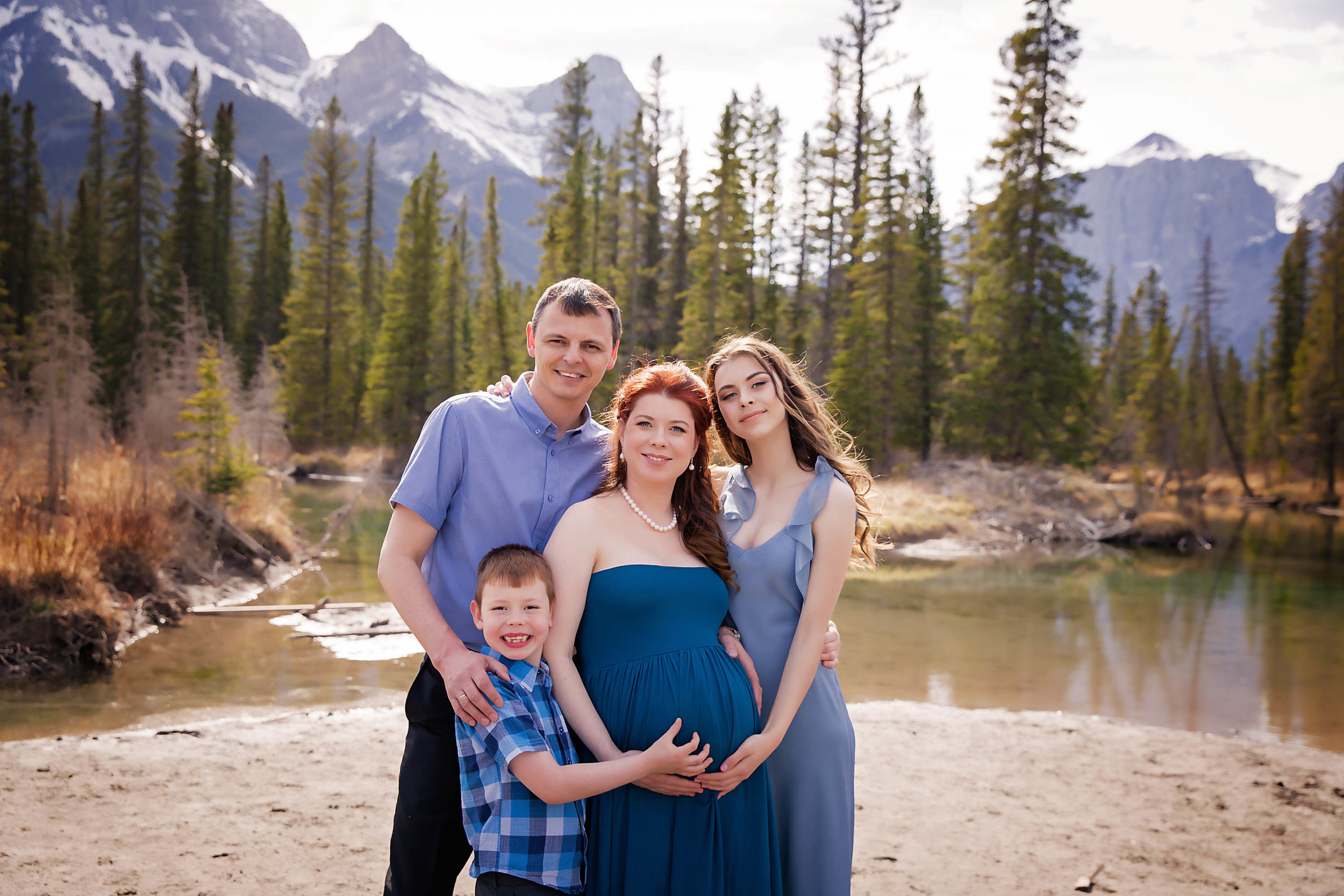 Family of 4 about to become a family of 5. Mountain maternity session in Canmore, Alberta. Calgary and Airdrie newborn and maternity photographer - Milashka Photography
