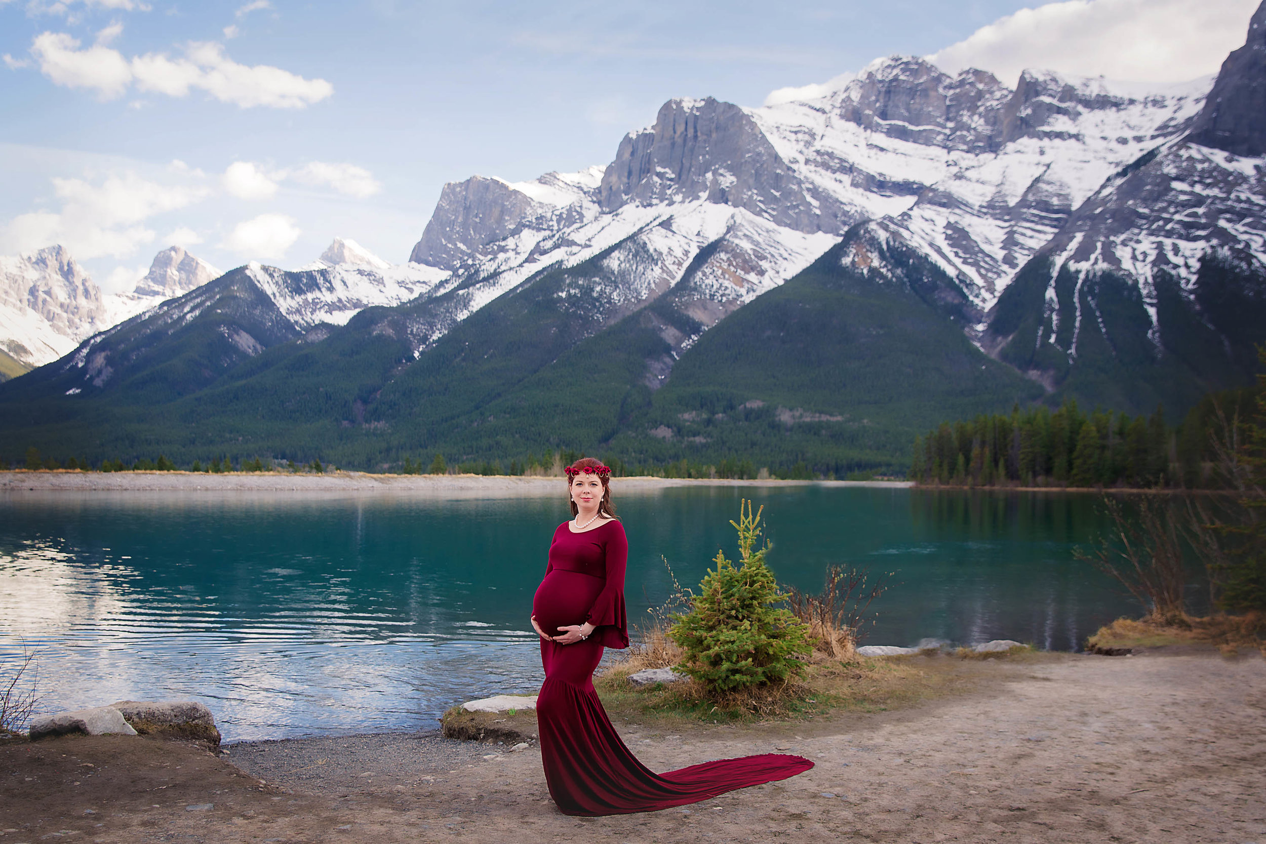 Mama in Red. Mom-to-be is wearing a red gown and posing in-front of mountains in Canmore, Alberta, Canada. Alberta maternity photographer - Milashka Photography