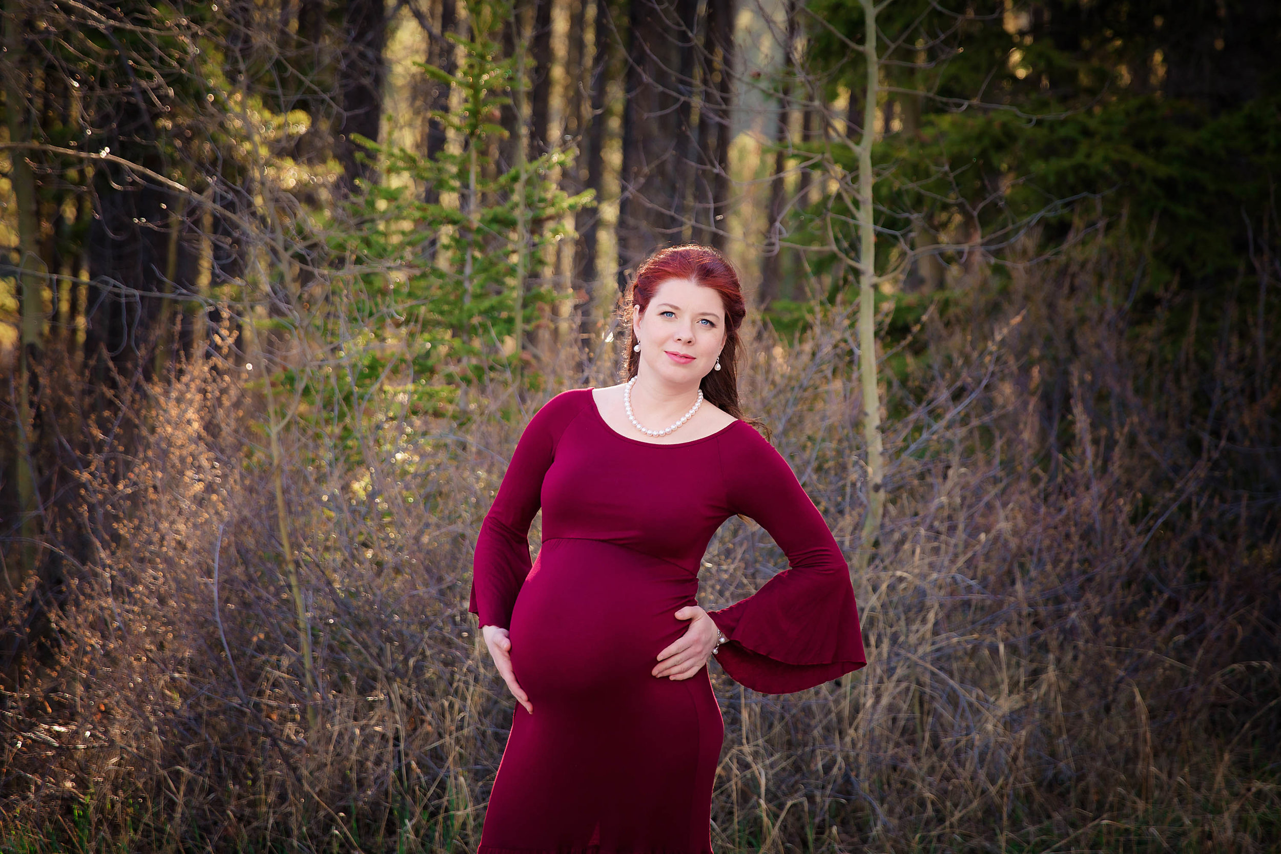 Mom-to-be in a red gown. Calgary and Airdrie maternity photographer - Milashka Photography