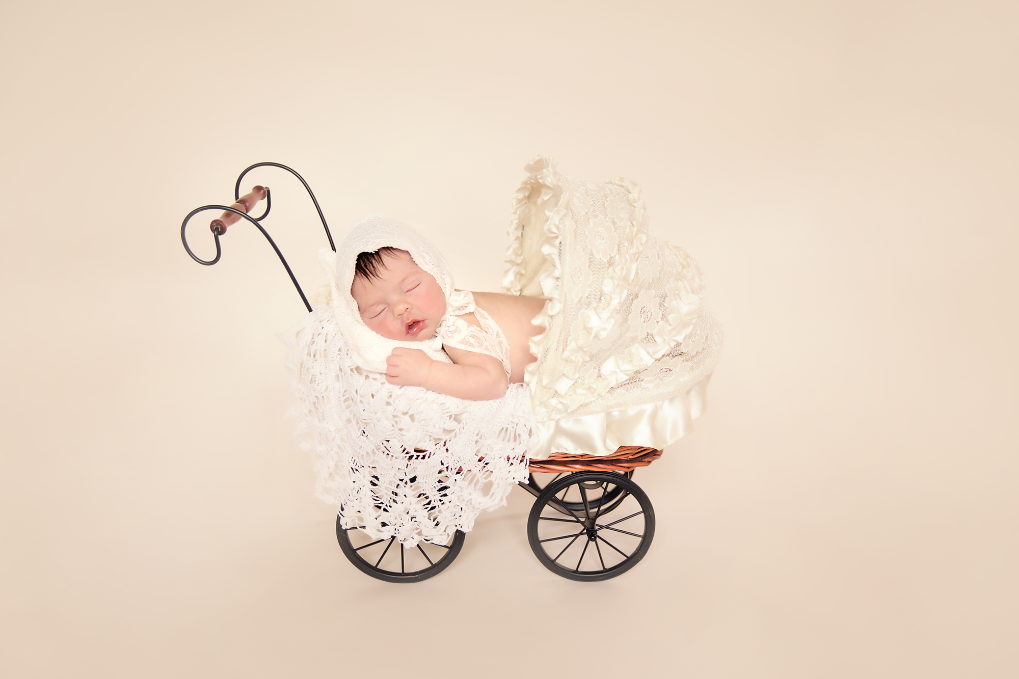 Newborn baby girl photoshoot idea. Calgary and Airdrie Newborn Photographer - Milashka Photography. Baby girl is posed in a stroller.