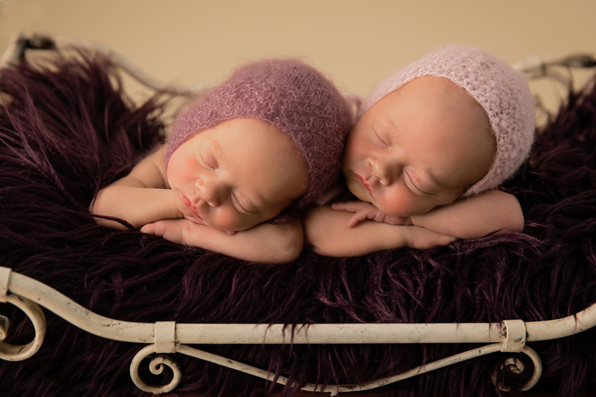 Identical Newborn Baby Sisters. Calgary photoshoot with Milashka Photography.