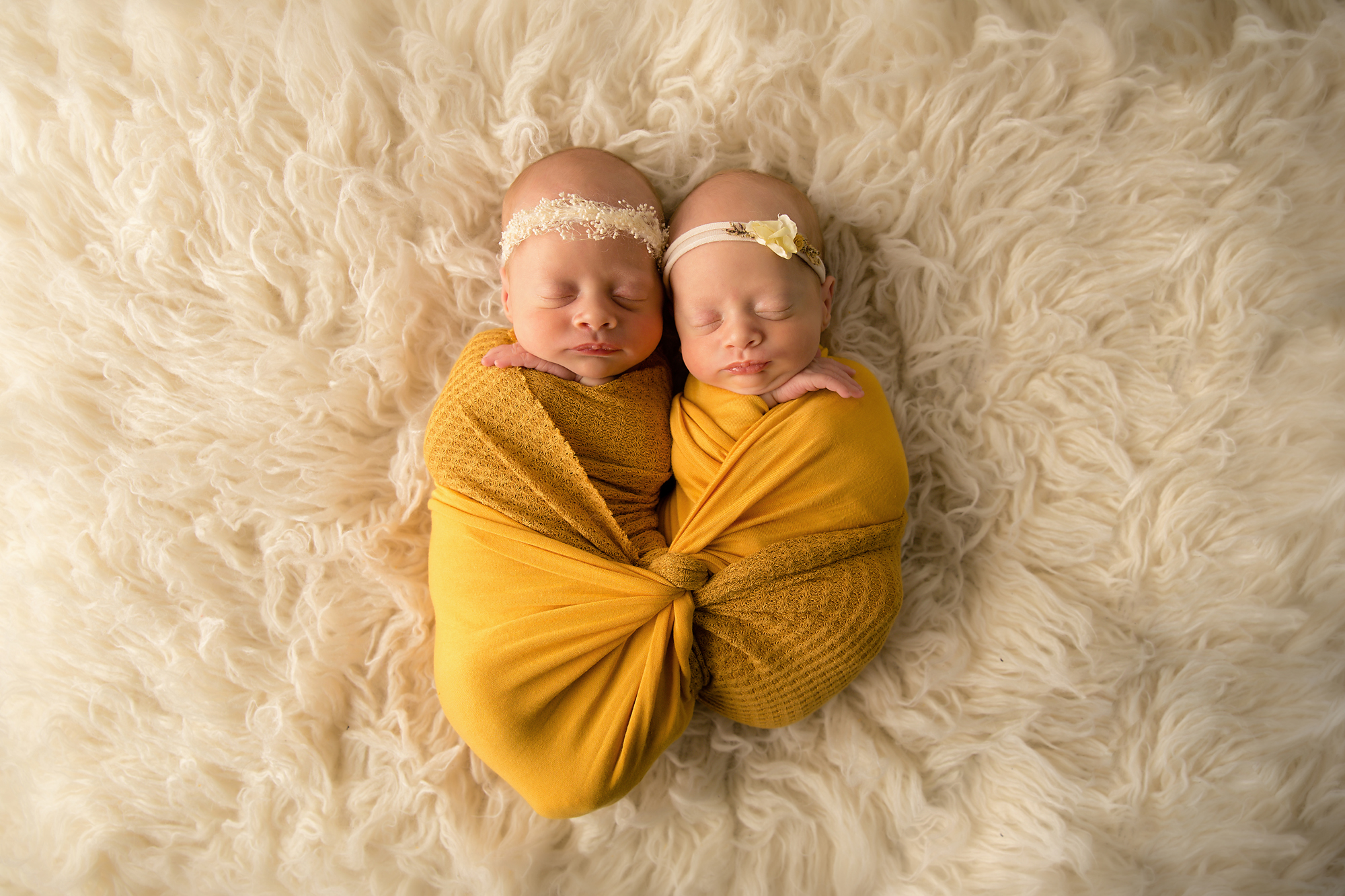 Twins Photography in Calgary, Alberta by Milashka Photography. One twin is 1 pound smaller then the other and it shows in this photo as they are both posed side by side.