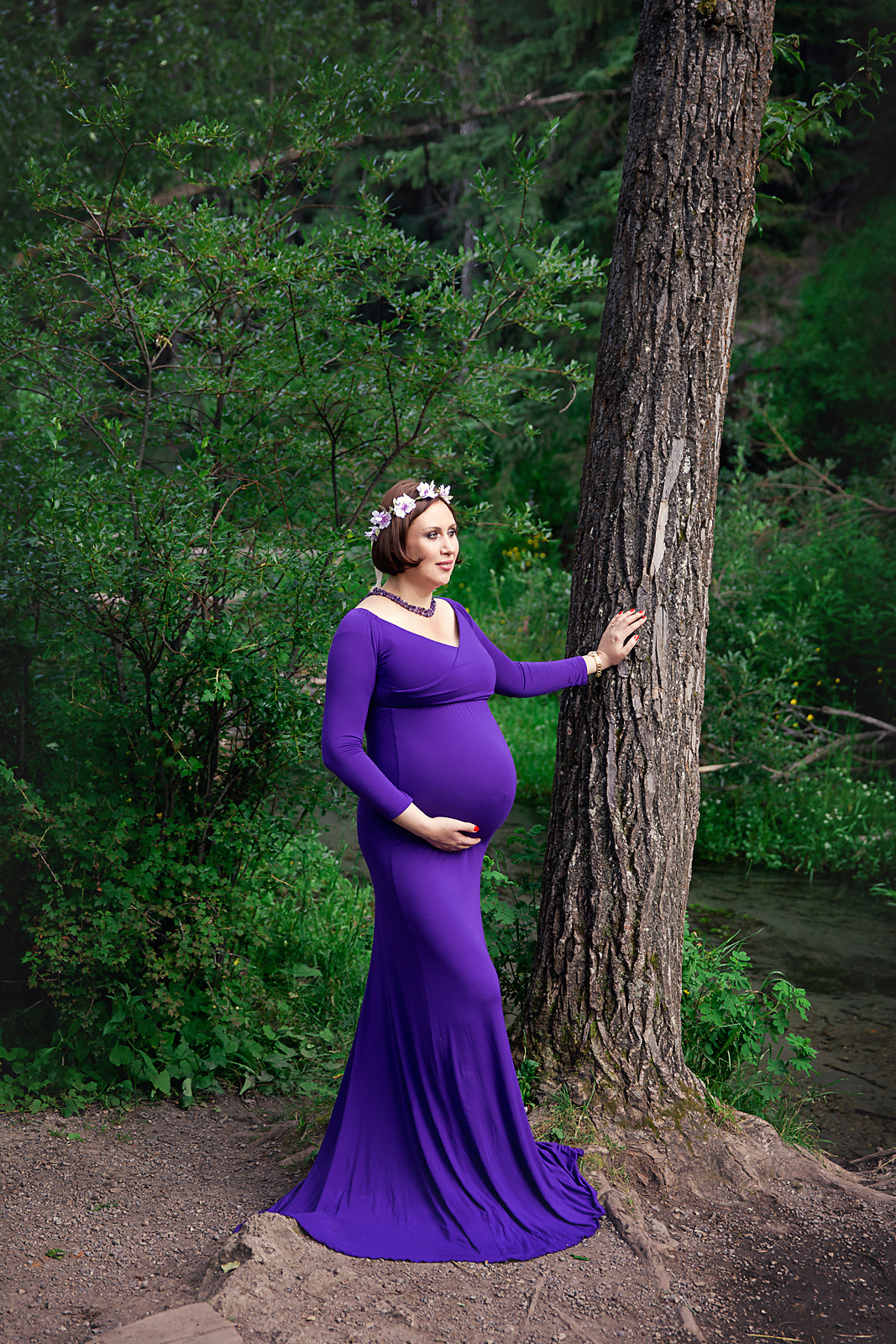 Mother-to-be in a purple gown