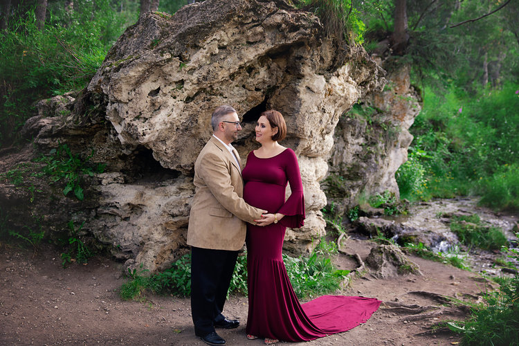 Parents-to-be are lovingly staring at each other during this maternity photoshoot. Calgary and Airdrie Maternity photographer