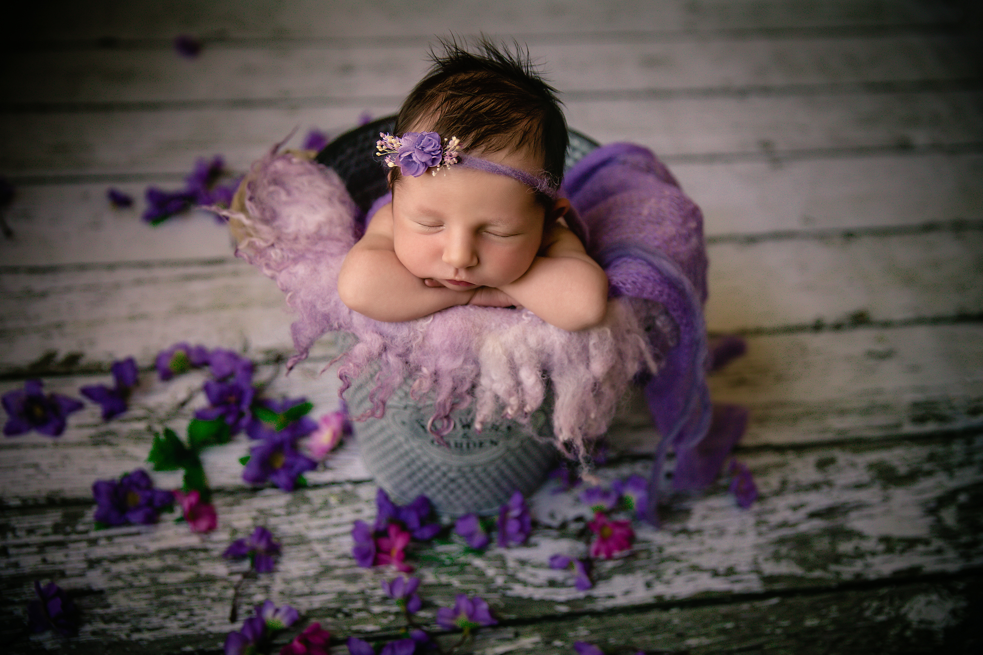 Newborn baby girl is posed in a bucket. Newborn Photoshoot ideas. Calgary and Airdrie newborn baby photographer - Milashka Photography