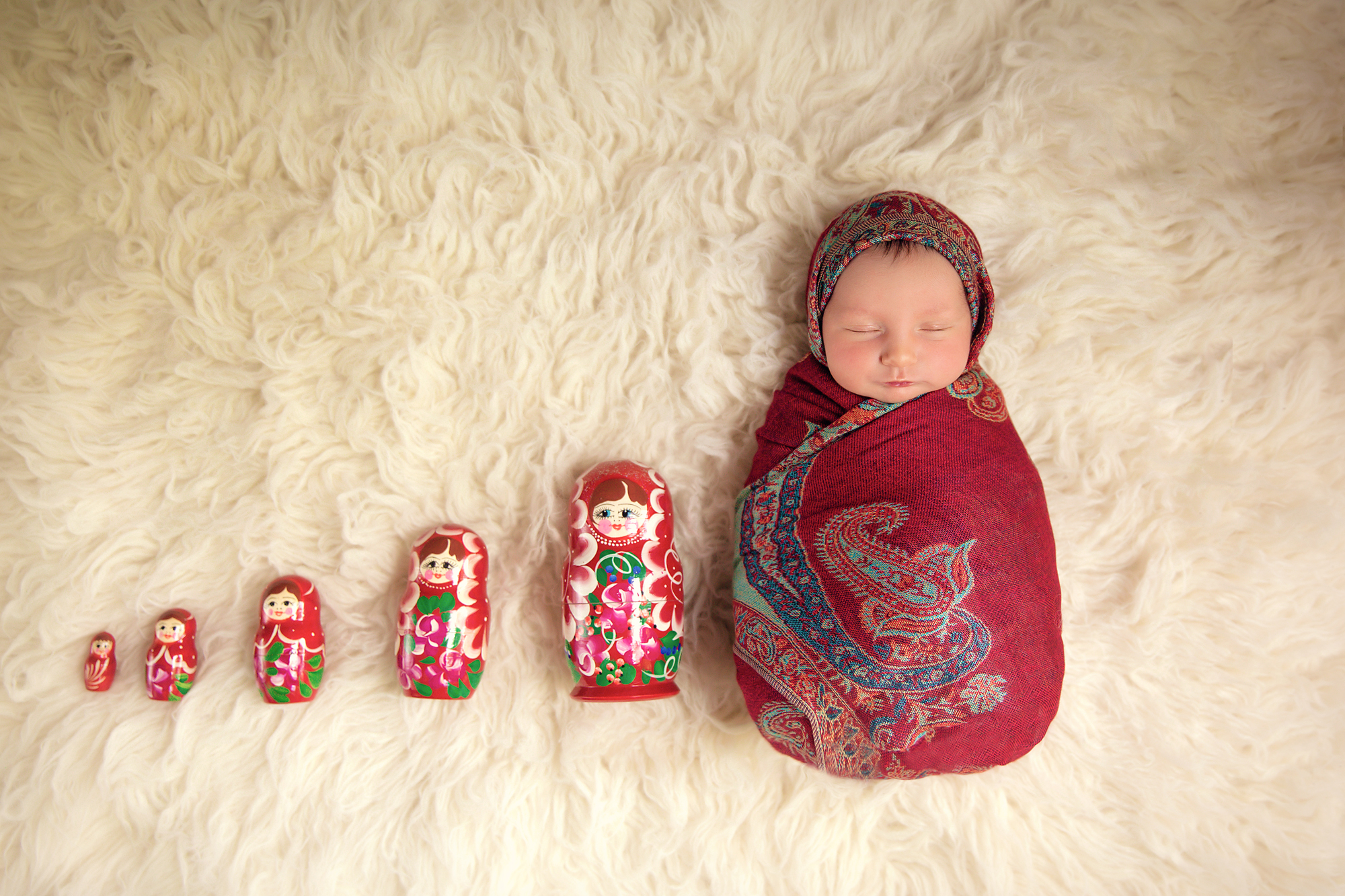 Russian doll. Baby girl is posed like a Russian doll aka Matryoshka. Newborn Photoshoot ideas. Calgary and Airdrie newborn baby photographer - Milashka Photography