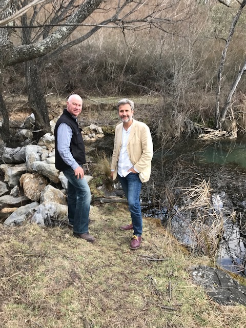 Chairman Gary Nairn AO (The Mulloon Institute)showing Professor John Crawford (Rothamsted Research)how much water continues to trickle through the leaky weir at Peter's Pond, despite current drought conditions across most of New South Wales.