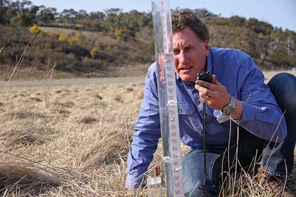 Luke Peel measures the water infiltration in the soil