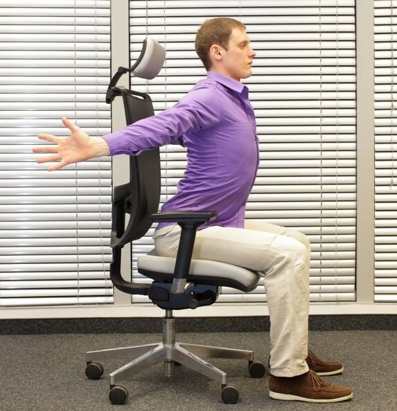 Open Chest Stretch - 1. Sit up straight and tall in your chair.2. Open your arms wide to make a T shape with your body. 3. Repeat again to make a Y shape with your body by raising your arms slightly overhead. 4. It is important to keep your thumps pointed up toward the ceiling.