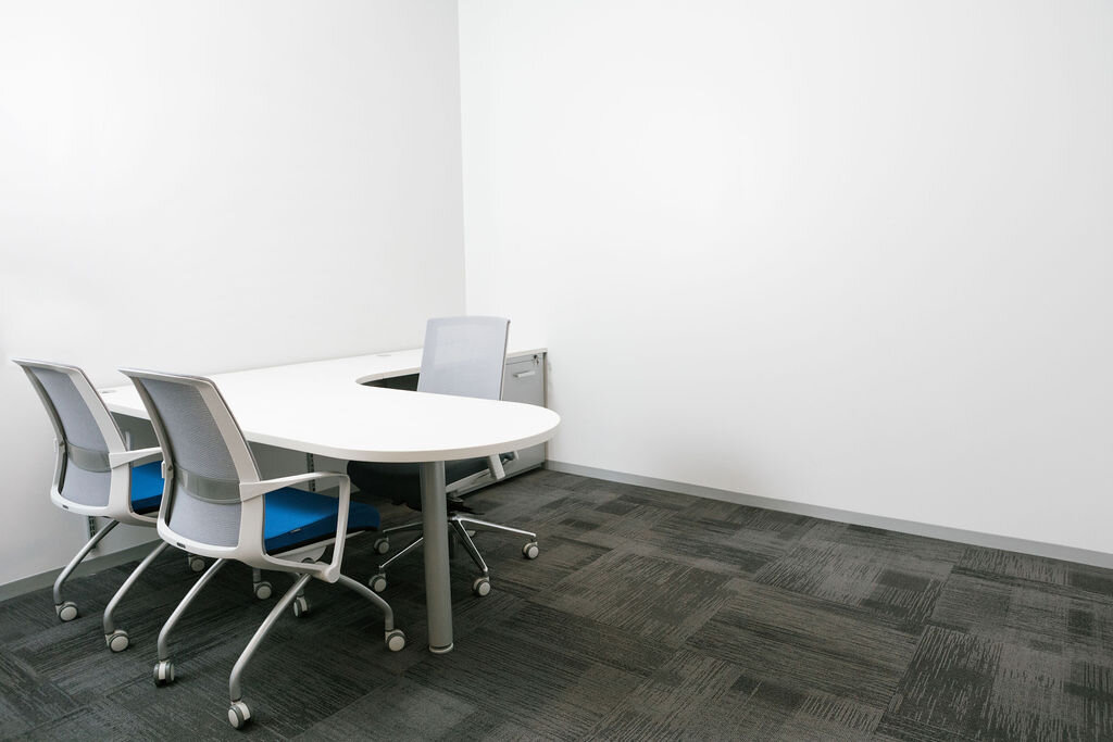 An unused private office allows plenty of space for the minimal footprint required by an onsite visit.