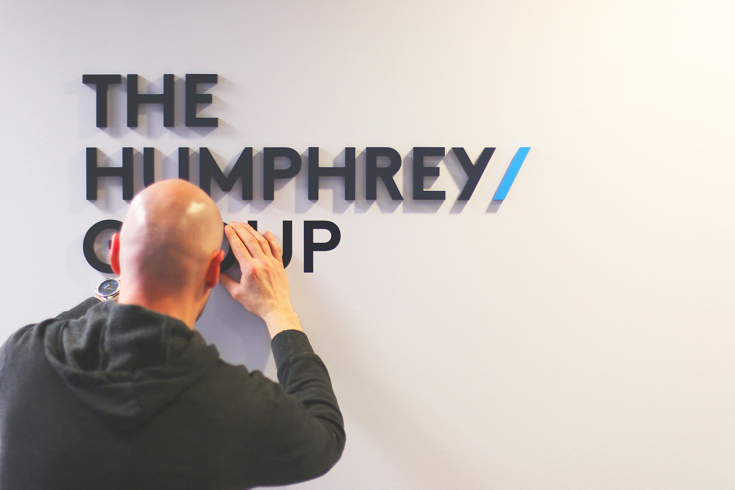 OUR VANCOUVER OFFICE SIGN GETS UPDATED.