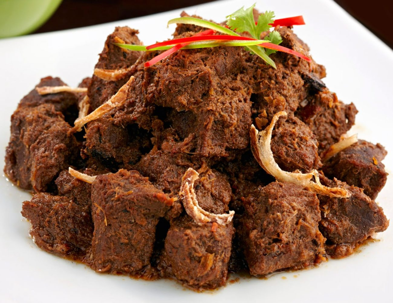 BEEF RENDANG MEAL   Generations-old family recipe of traditional Indonesian beef rendang with a healthy twist. Slow cooked grass feed beef marinated in coconut milk & Balinese spices   65K IDR
