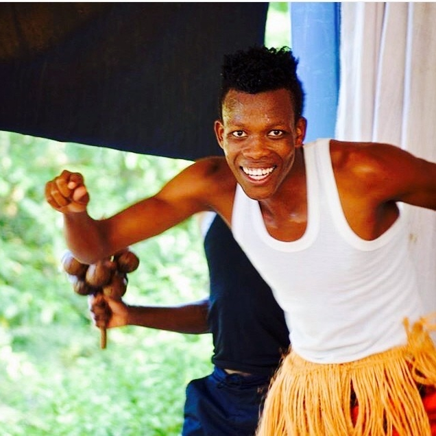 BRAYSON SILAS - Many people like to imitate Brayson's dancing style. He's developed a unique approach to dancing that quickly identifies him. He hails from Kilimanjaro where he performed with different groups before joining the project. Aside from dancing and playing drums he does acrobatics.