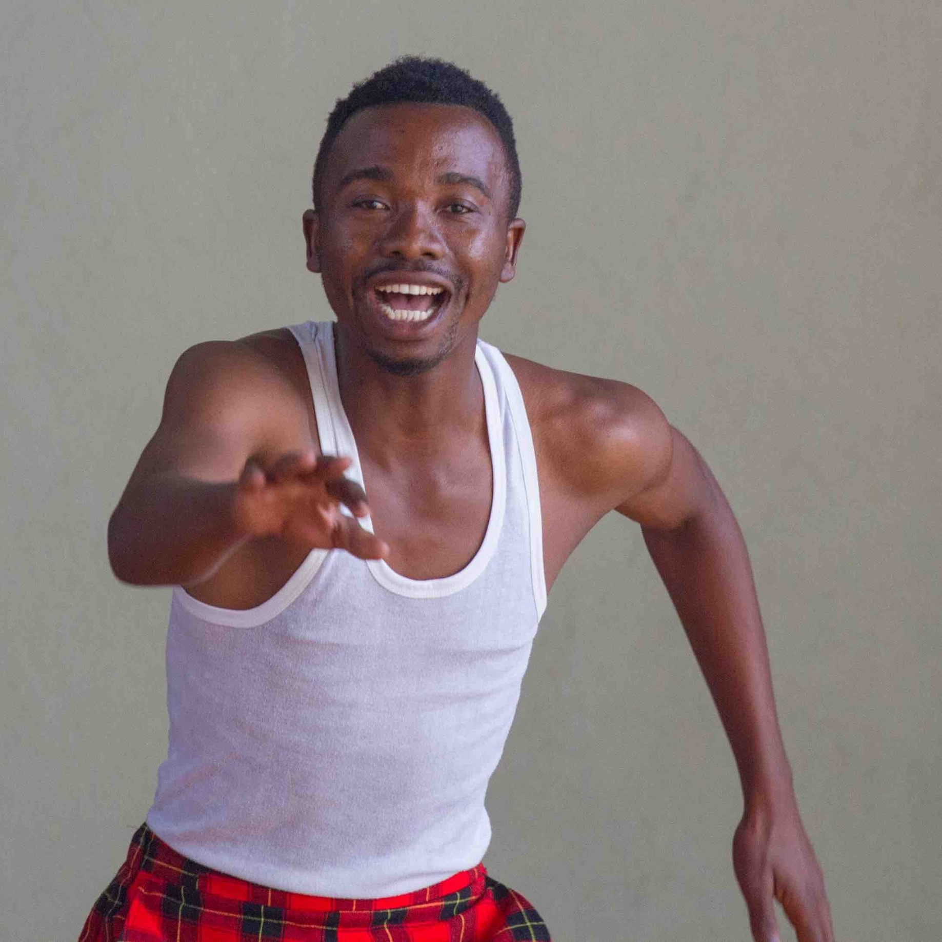 MARIJANI ALLY MROPE - Marijani began by studying dancing,drumming and acting in the Cultural Revolution Group in Leganga, Usa River. He also studied African dance at the United African Alliance Community Center (UAACC). As well as dancing, he has acted in films, and does stand up comedy.