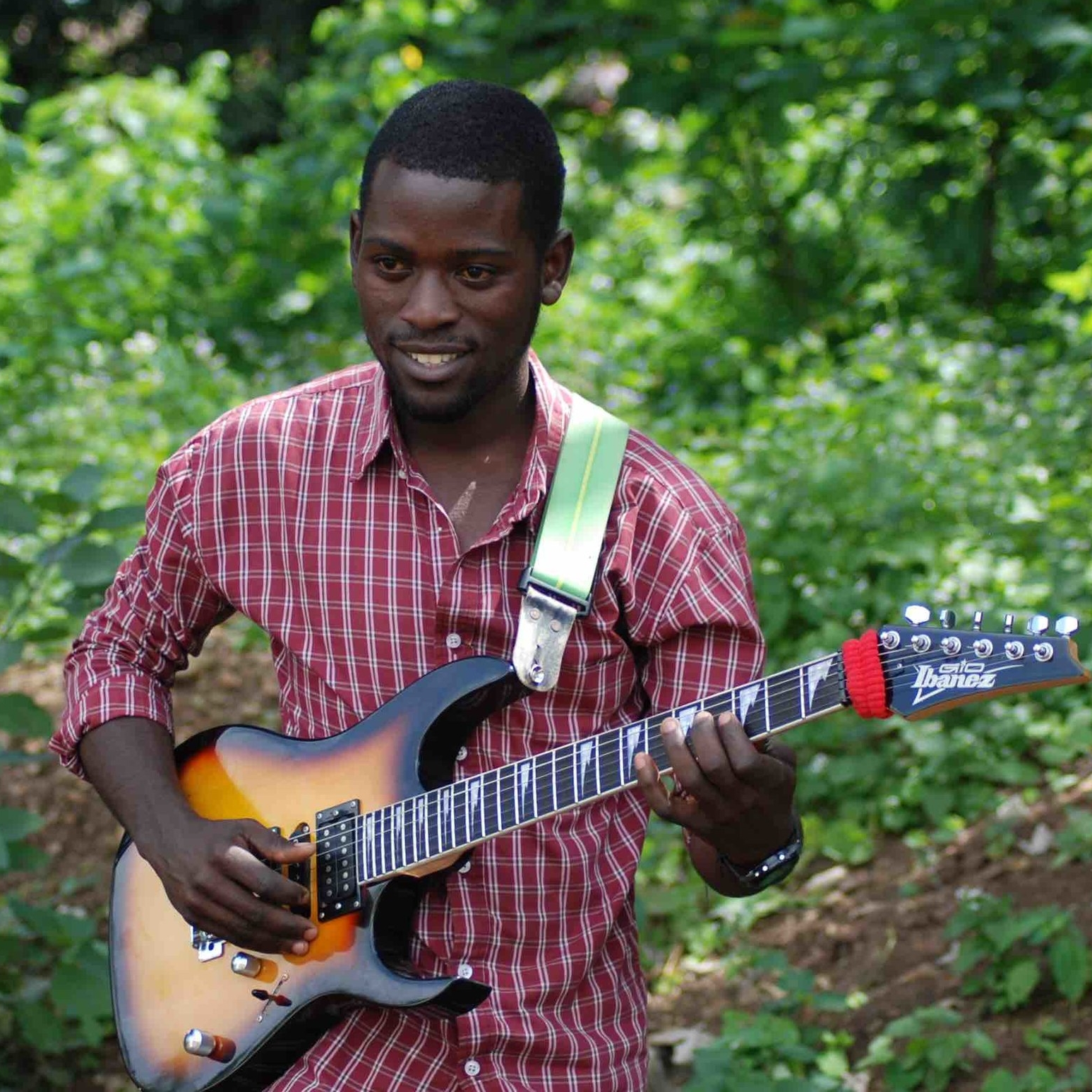 ELKANA GEORGE - Elkana taught himself about music and to play guitar, as well as learning in church. He was later taught guitar by Gibson Bukuru. He plays lead guitar in the CAC fusion band, and his highlight has been performing at Sauti za Busara 2017 and 2018. He has also performed at Twenzetu kwa Yesu at the Jamhuri Stadium, Arusha and the Extravaganza Festival, National Stadium, Dar es Salaam.