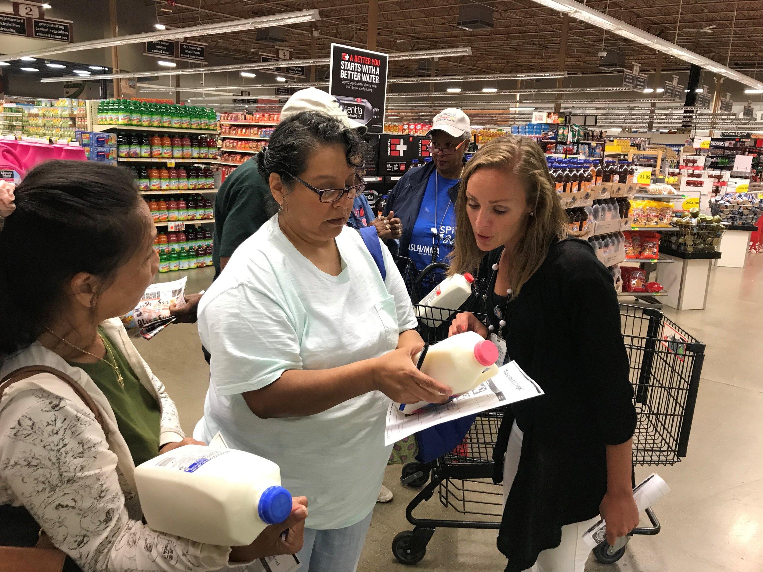 Dietitian explaining how to read milk food labels.jpg