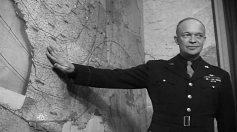 Eisenhower with map of Normandy