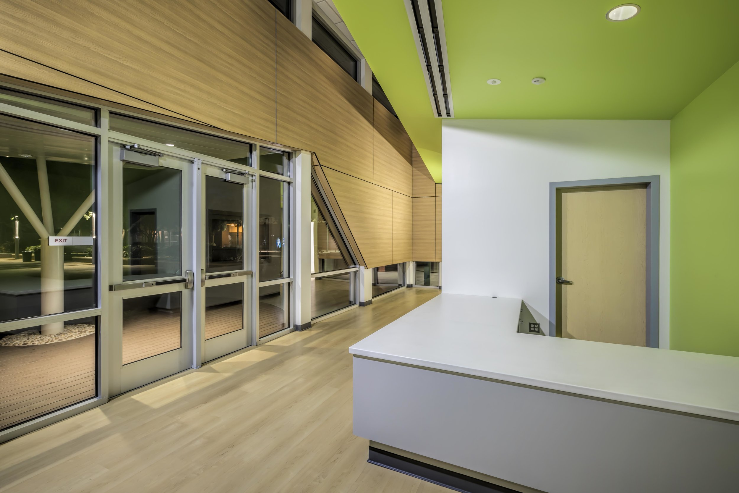 A high volume and natural light spill into the lobby space.