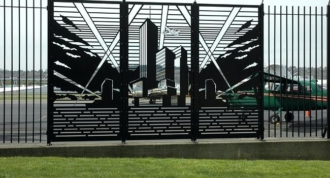 Ornamental steel fencing with accent infill panels (Image property of brandonemrich.com)