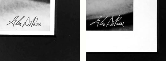 Signature is written in the lower right hand corner of the printed image area using white pigmented ink if area is dark or black pigmented ink if area is light