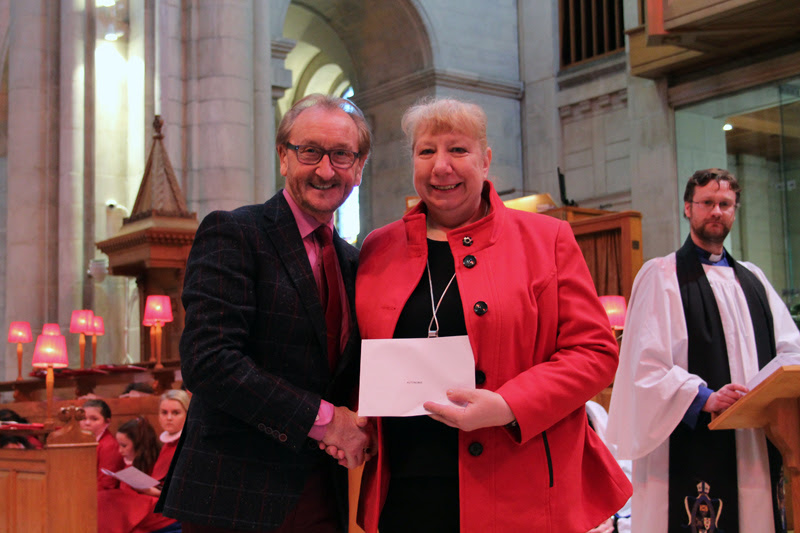 Entertainer George Jones pictured at St Anne's in Belfast City Centre where he presented Lynne Morrison with grants money with the annual Black Santa collection.