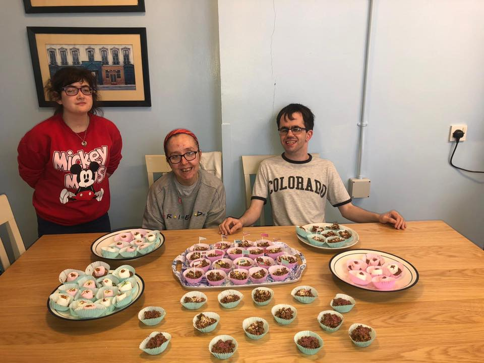 Freedom2Choose programme young people Robyn, Niamh and Gary baking delicious buns ahead of Saturday's 'World's Biggest Coffee Morning' event at Lilac House in aid of Macmillan Cancer Support.