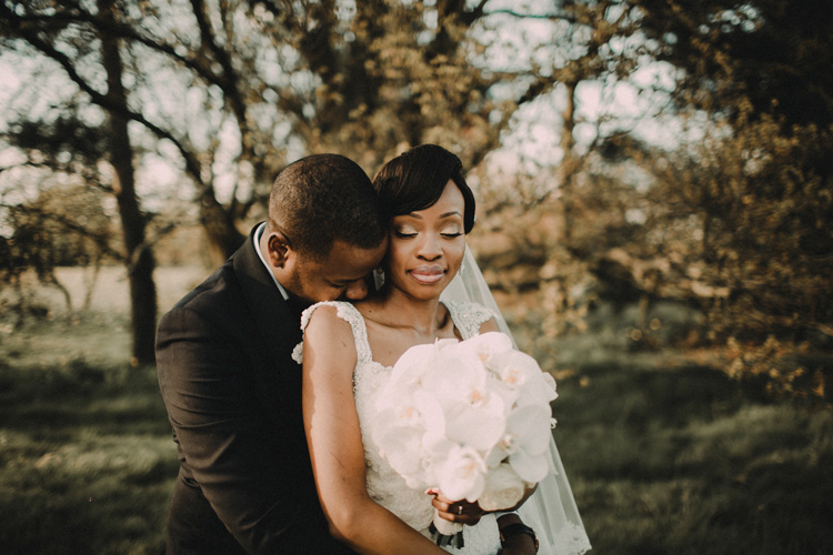 classy bride sharing intimate moment with groom at hylands house