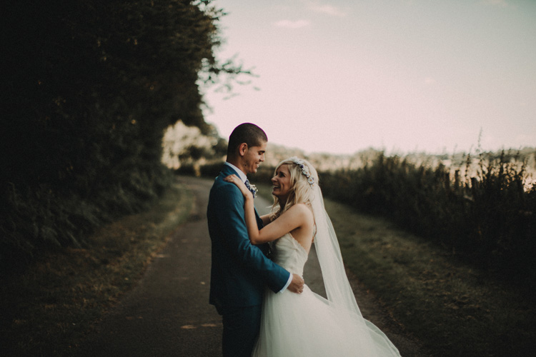 boho bride and groom hold each other in intimate moment in chesham wedding