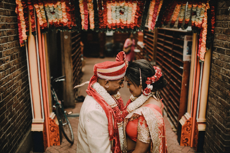 couple share moment after hindu ceremony in temple