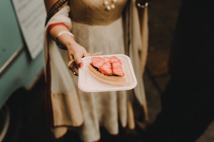 hindu bride shows dessert at hindu wedding reception