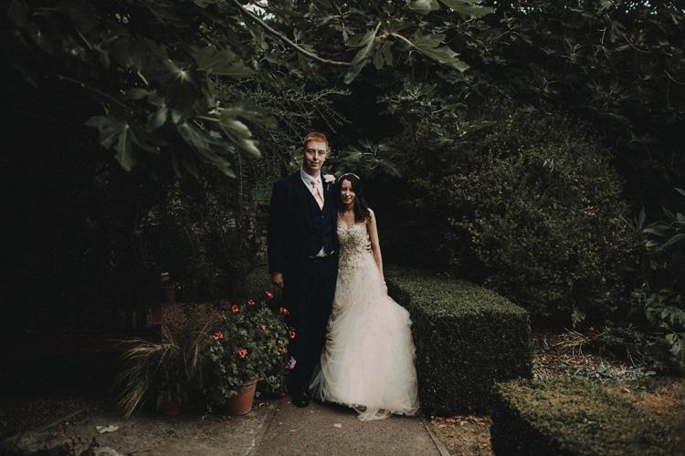 groom holds bride in quex park wedding
