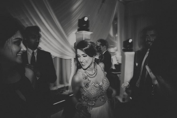 arab bride dancing at hindu wedding reception in southampton